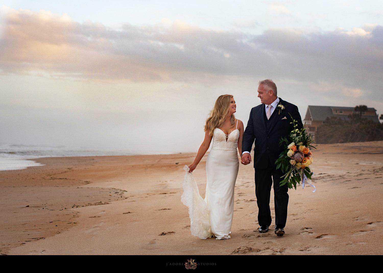 Bride and groom walking on beach in Saint Augustine Florida