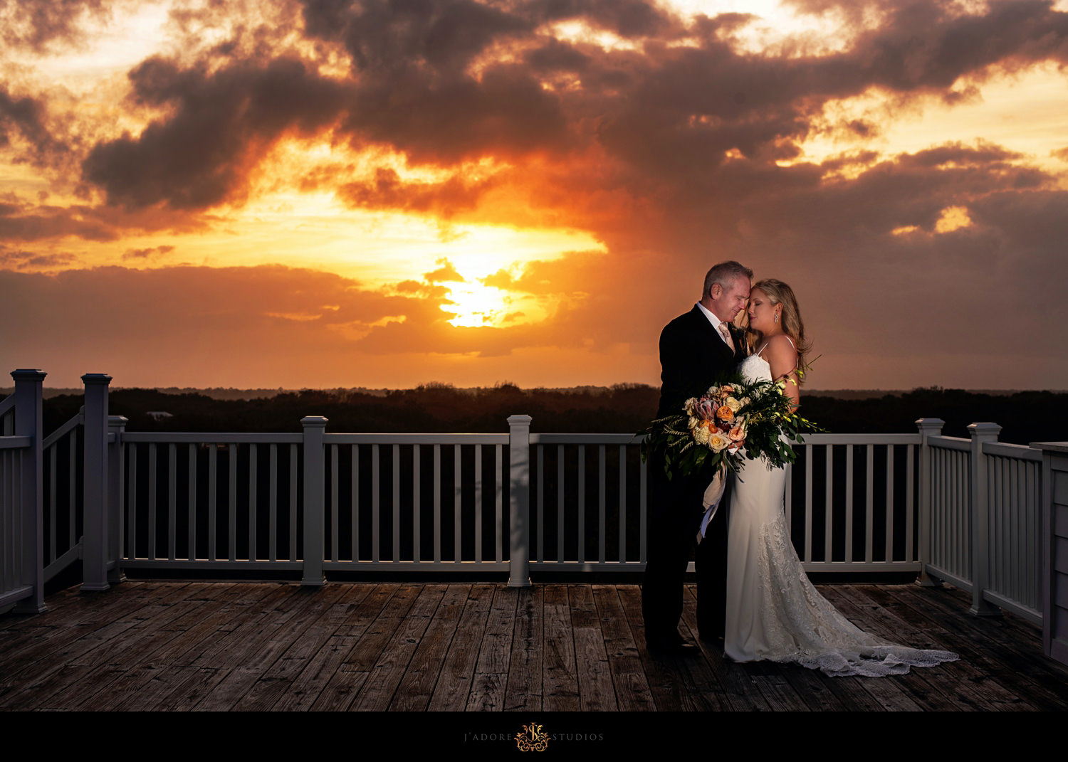 Bride and groom in front of Saint Augustine Florida sunset