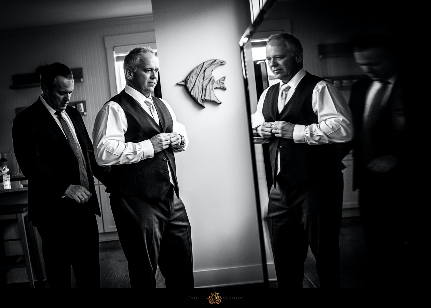 Groom getting ready with a reflection