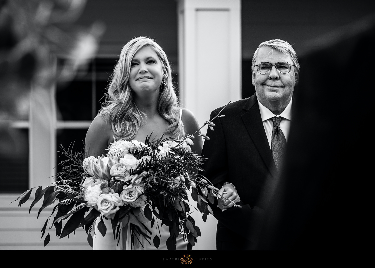 Bride crying walking down the aisle with her father