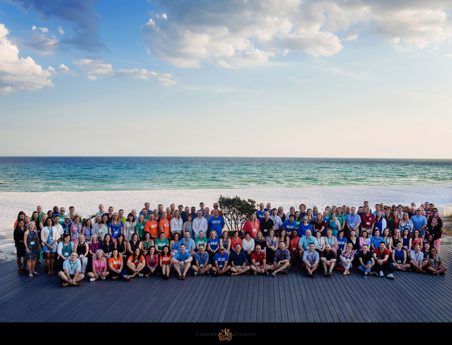 Corporate Event Group Photo in front of beach in Florida