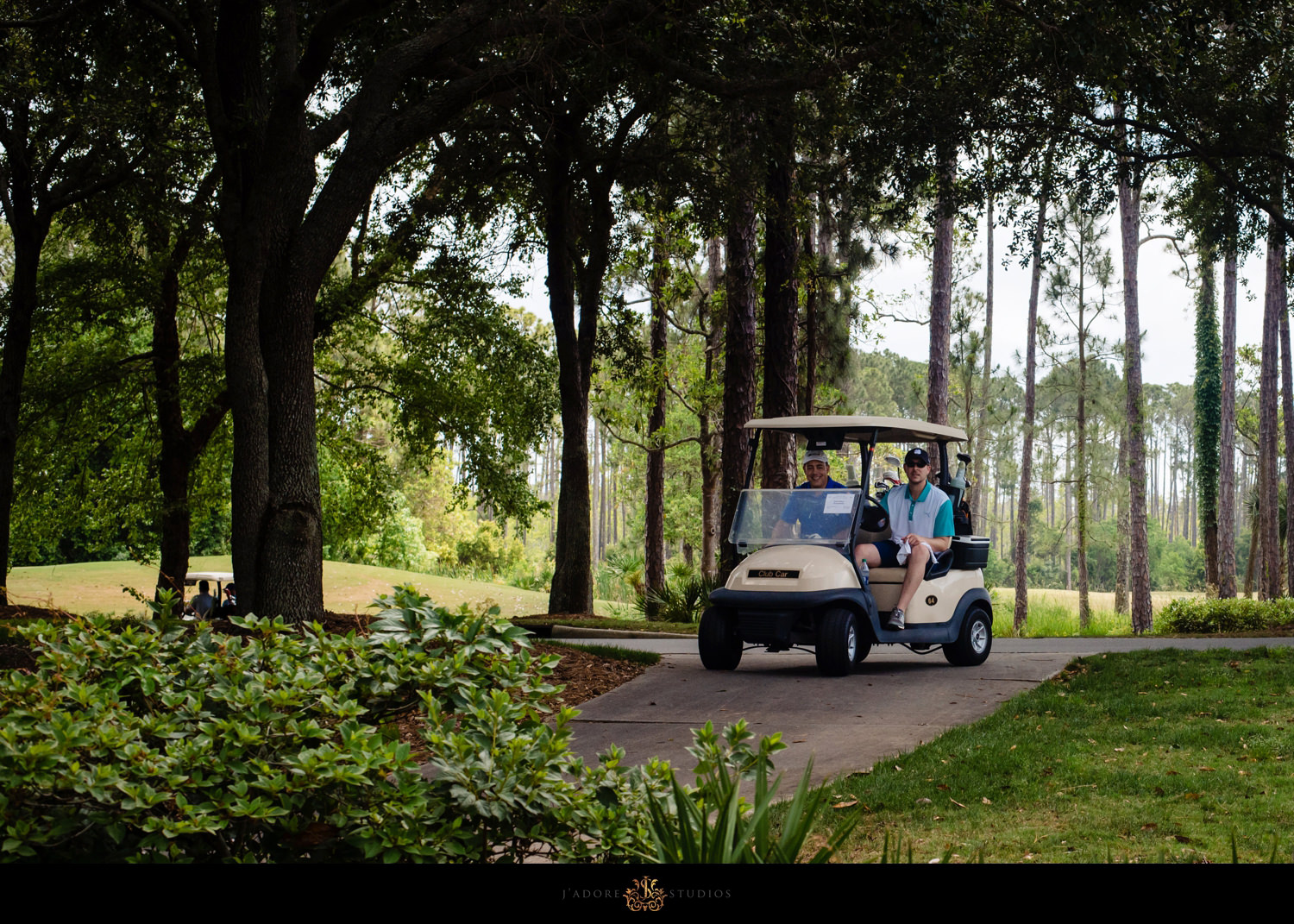 Corporate Event - Two men in golf cart