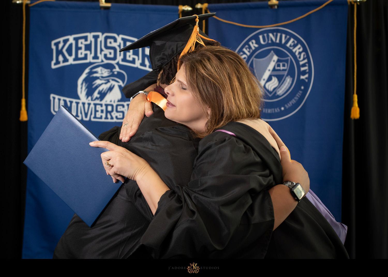 Keiser University President Winslow hugs student