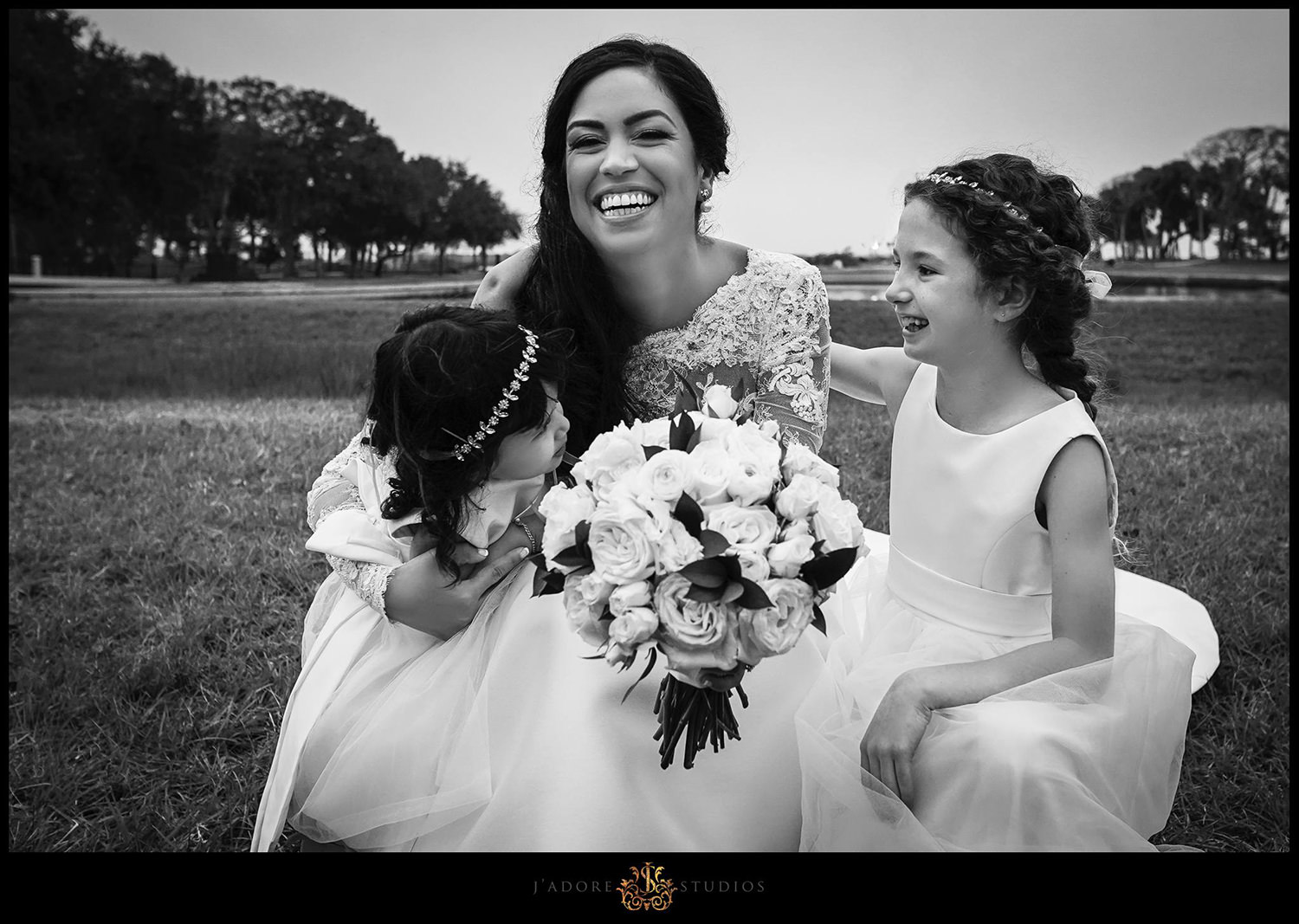 Laughing bride with her two flower girls at Our lady of la Leche in Saint Augustine Florida