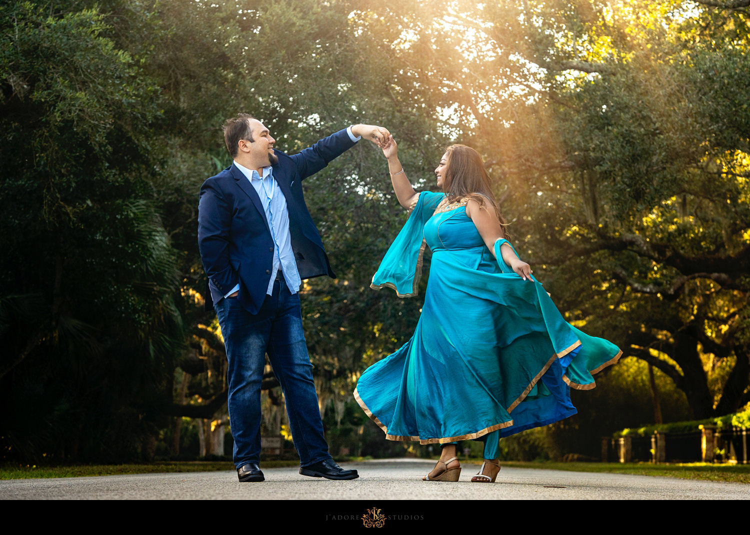Couple dancing in Washington Oaks State Park Florida.  Indian bride