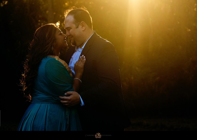 Couple kisses in sunrise light at Washington Oaks State Park