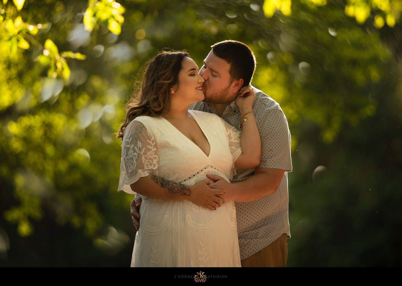 Golden hour photo of groom kissing bride's cheek
