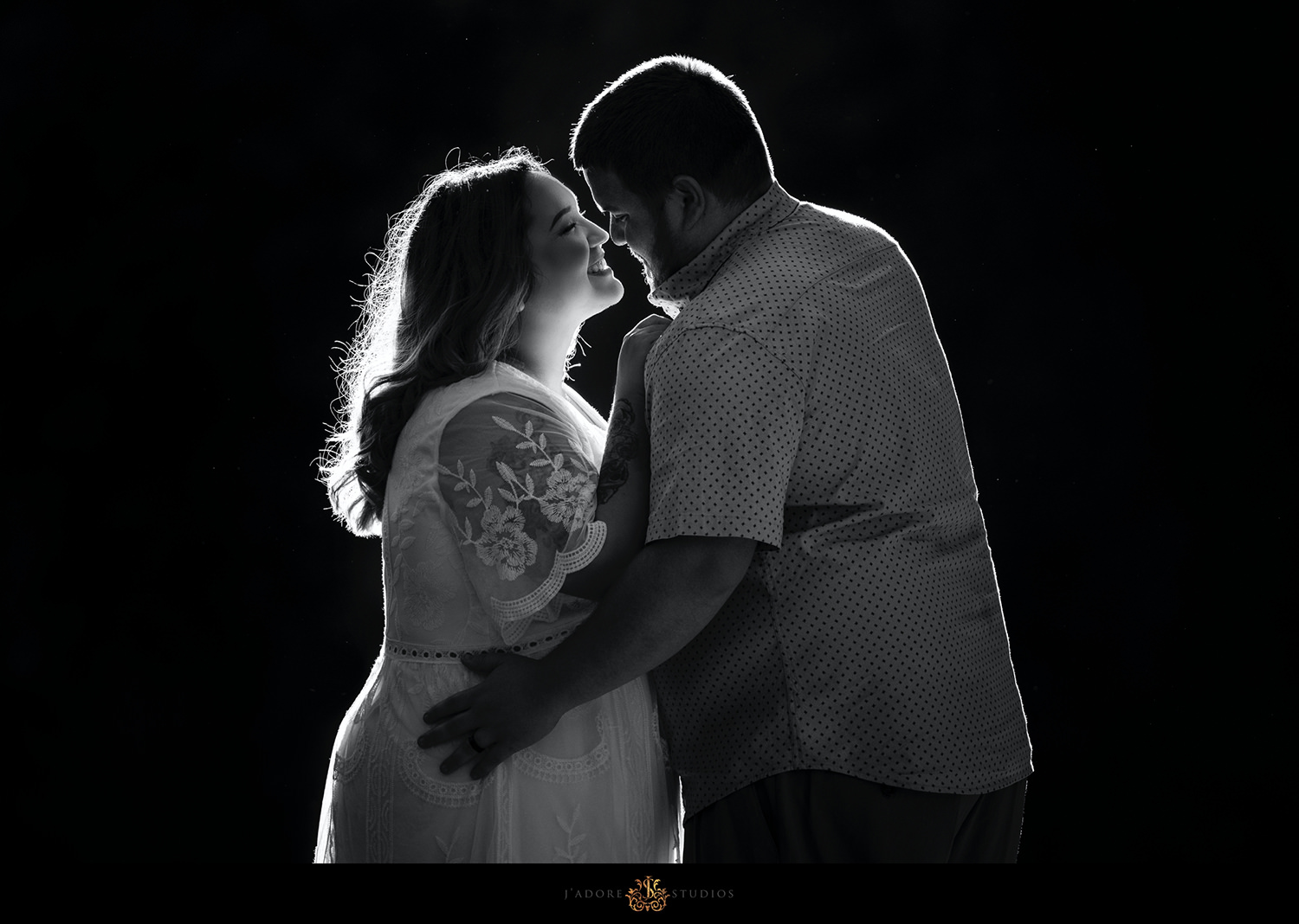Black and white image of bride and groom in backlit sun light