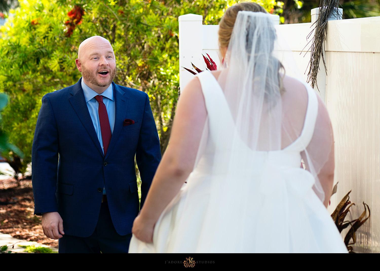 surprised groom during first look