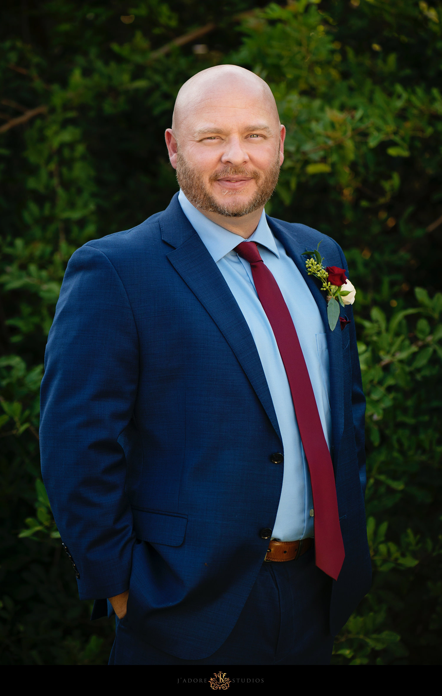 Groom portait in a navy blue suit