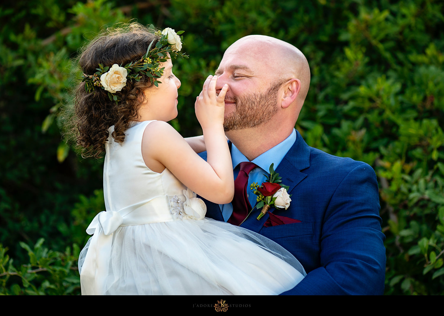 Groom laughing with daughter