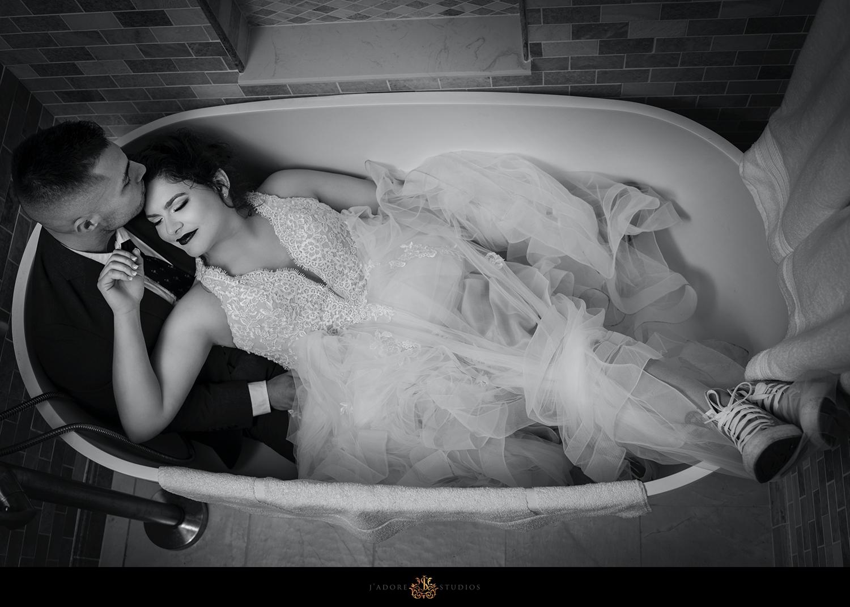 Couple cuddling in a bath tub