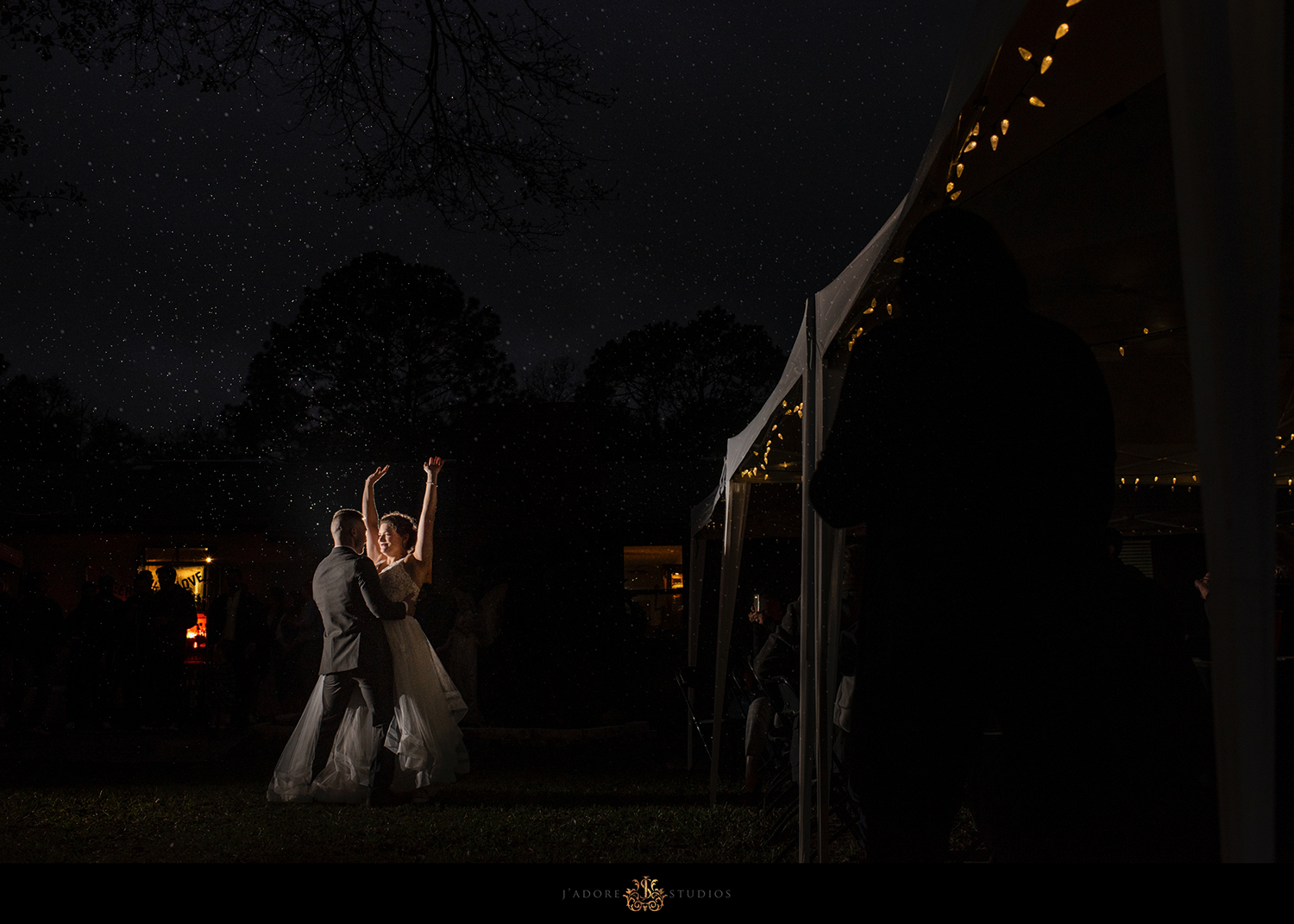 couple having their first dance in the rain