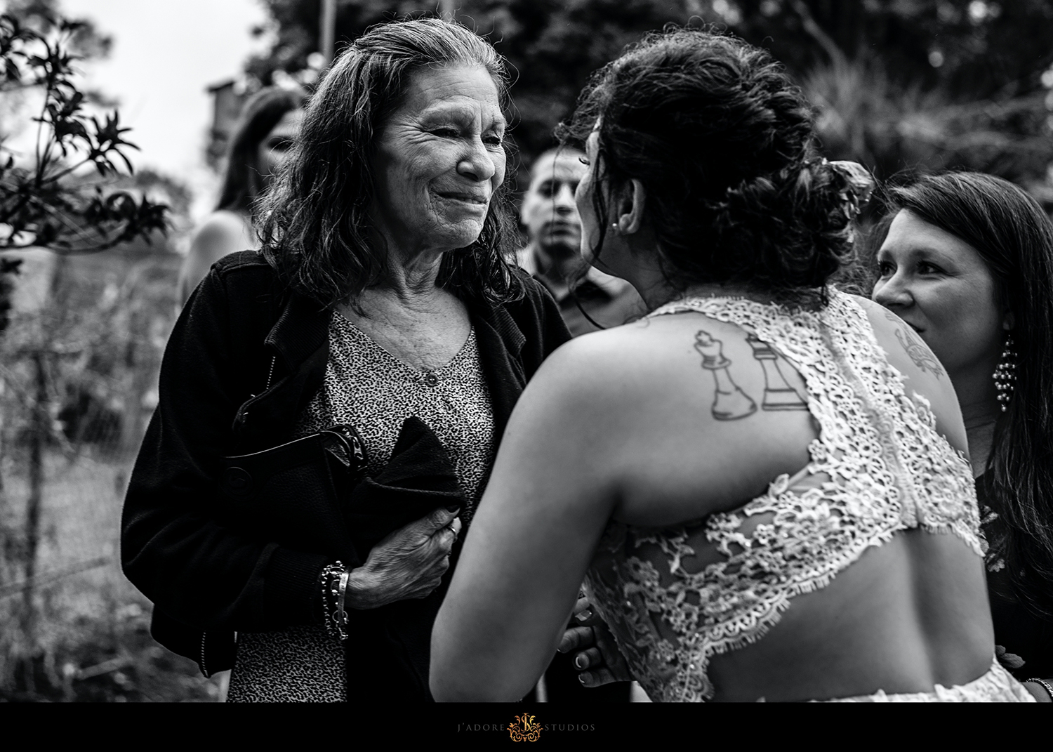 mom hugs daughter after she gets married