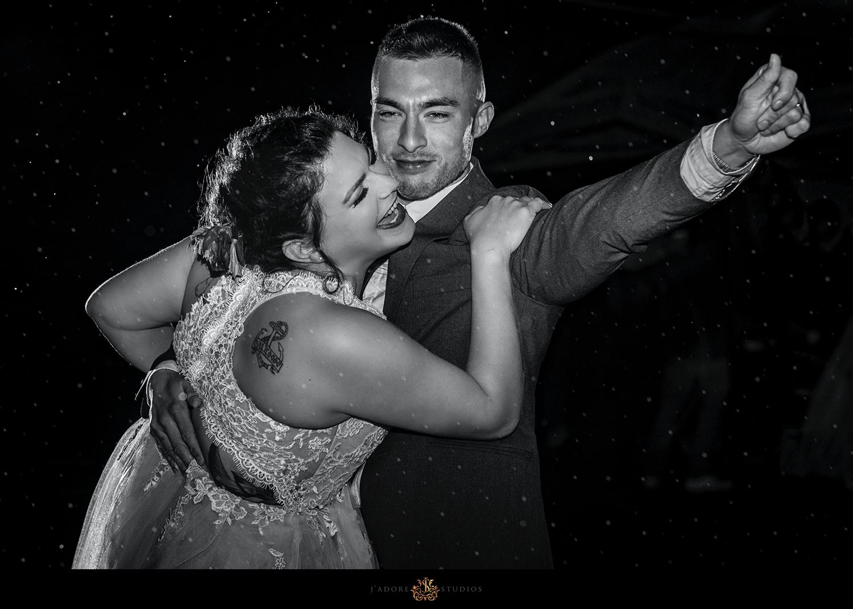 couple dances their first dance in the rain