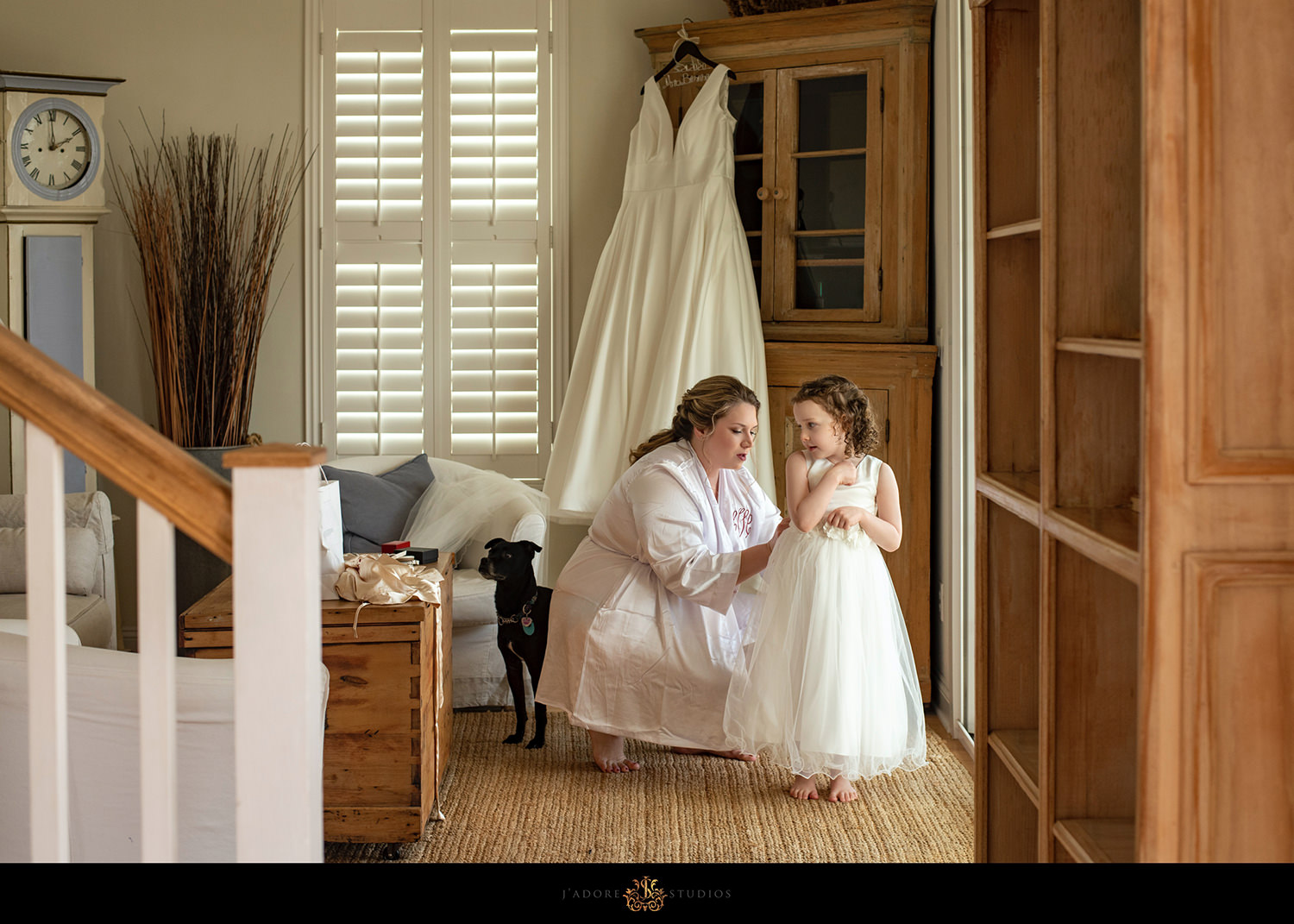 Bride and daughter getting dressed