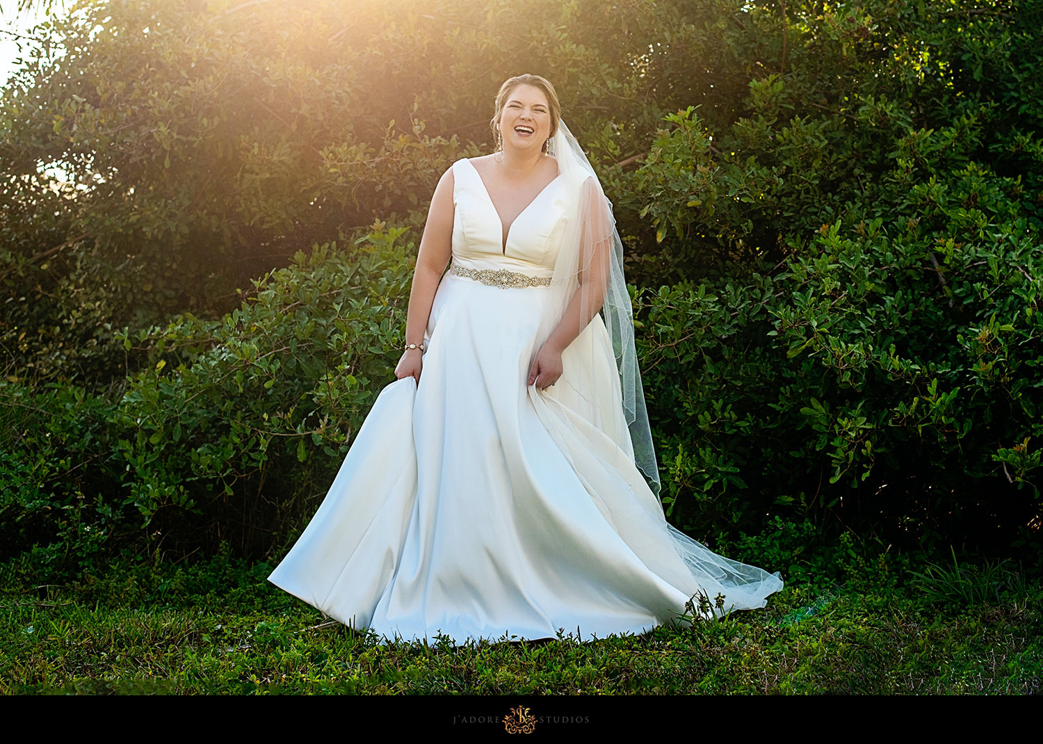 Bride laughing in golden sunlight