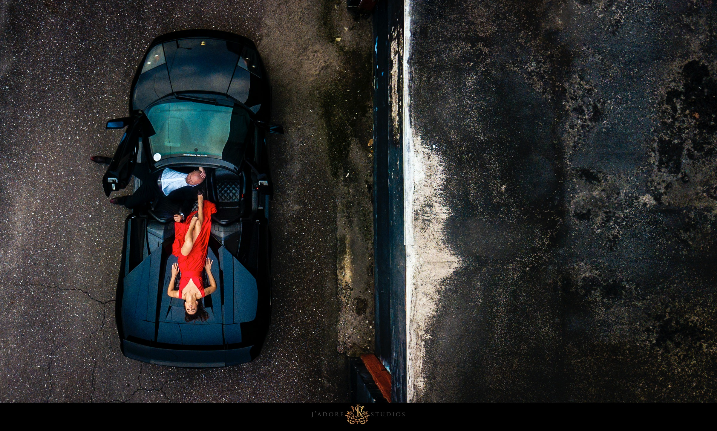 drone photo of couple laying in a Lamborghini in Jacksonville Florida