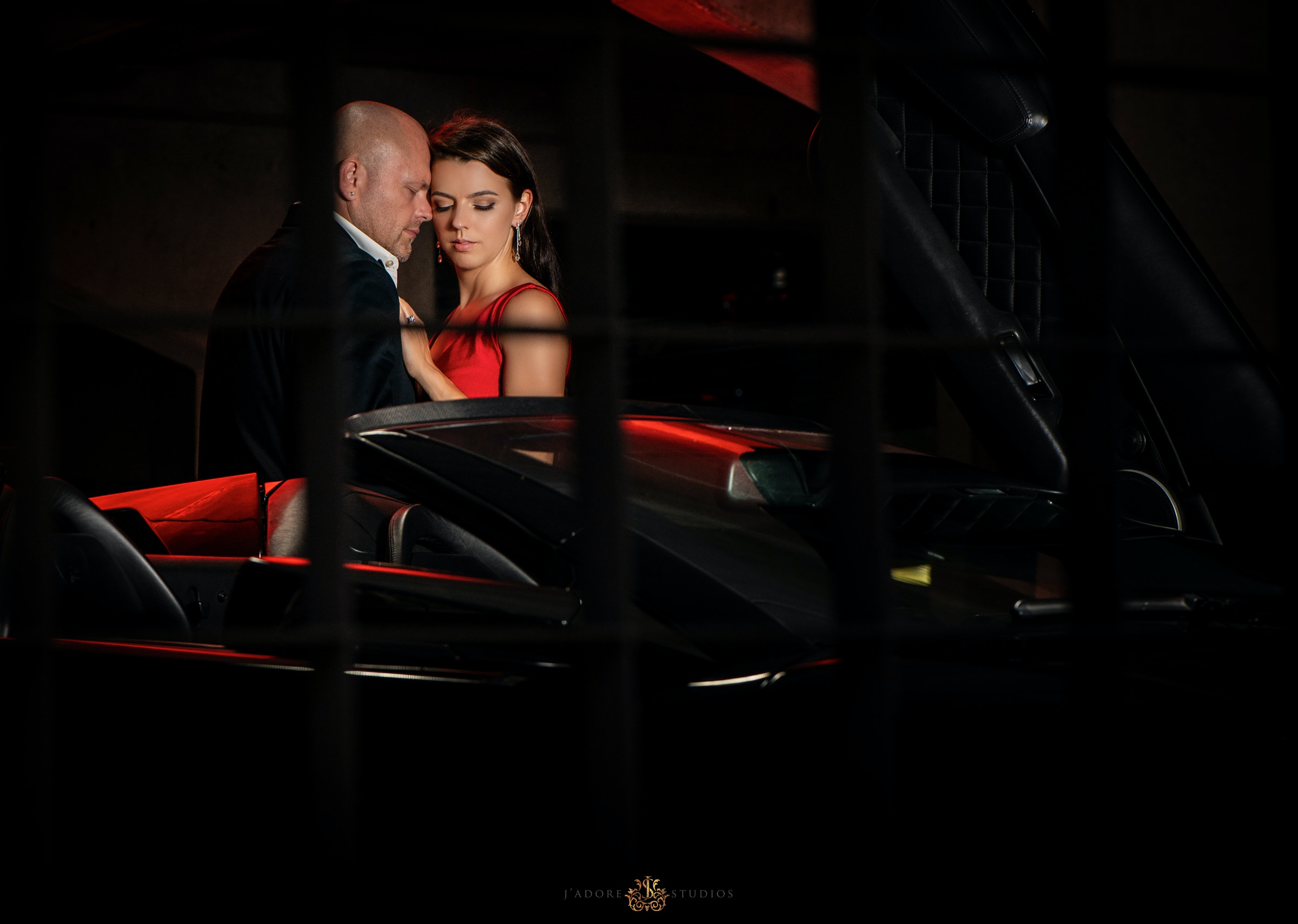 groom kissing brides cheek in a Lamborghini