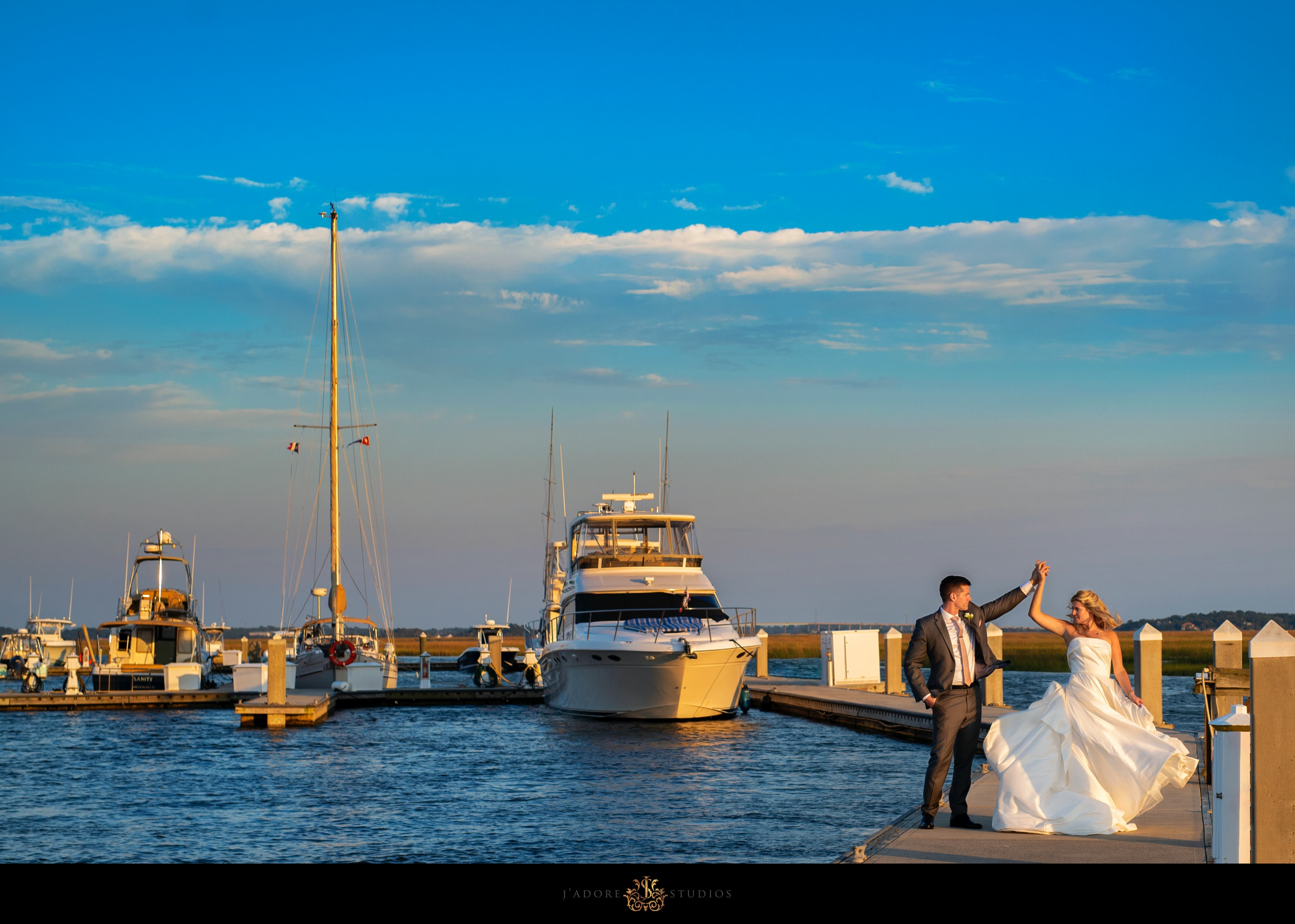 Couple dancing on the dock at the marina at Oyster Bay Yacht Club Jacksonville Wedding Venue