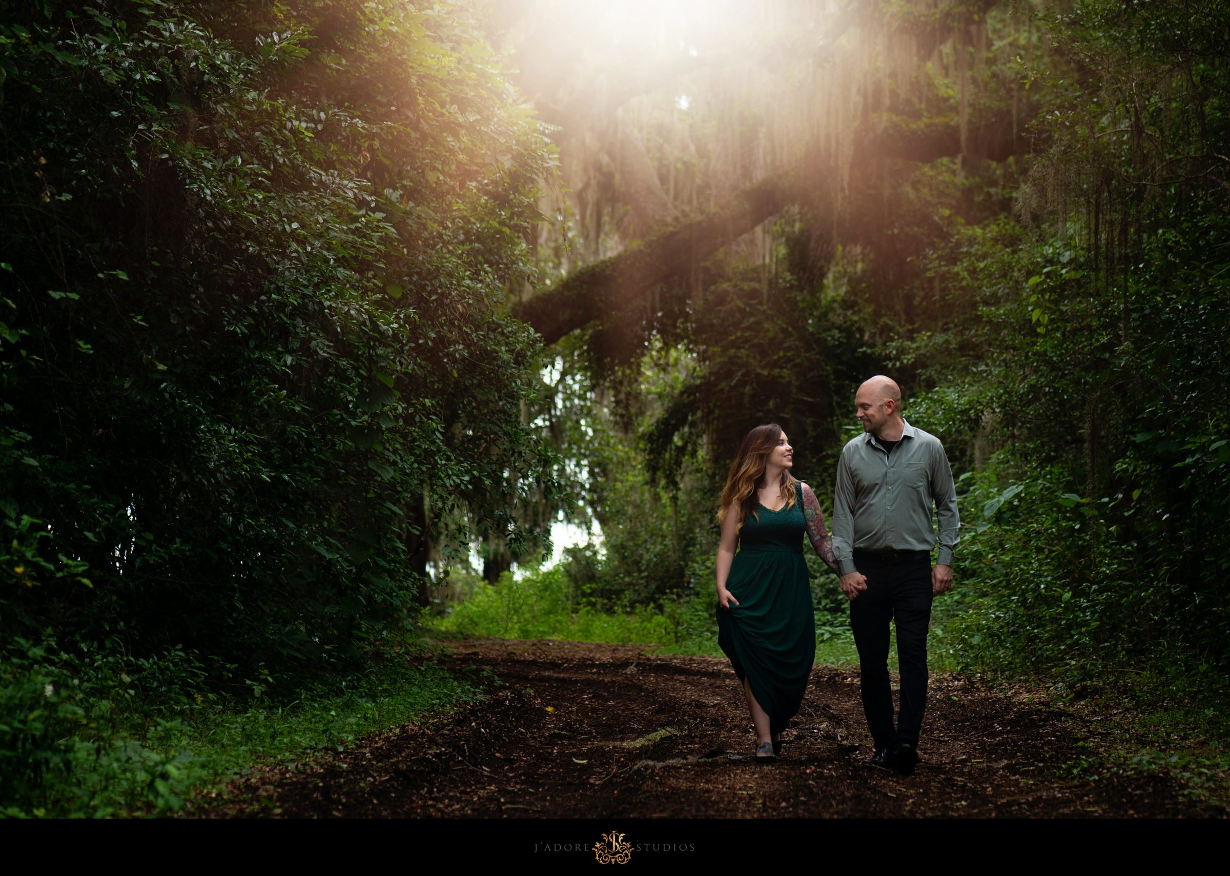 Couple walking in a park with rays of sunshine