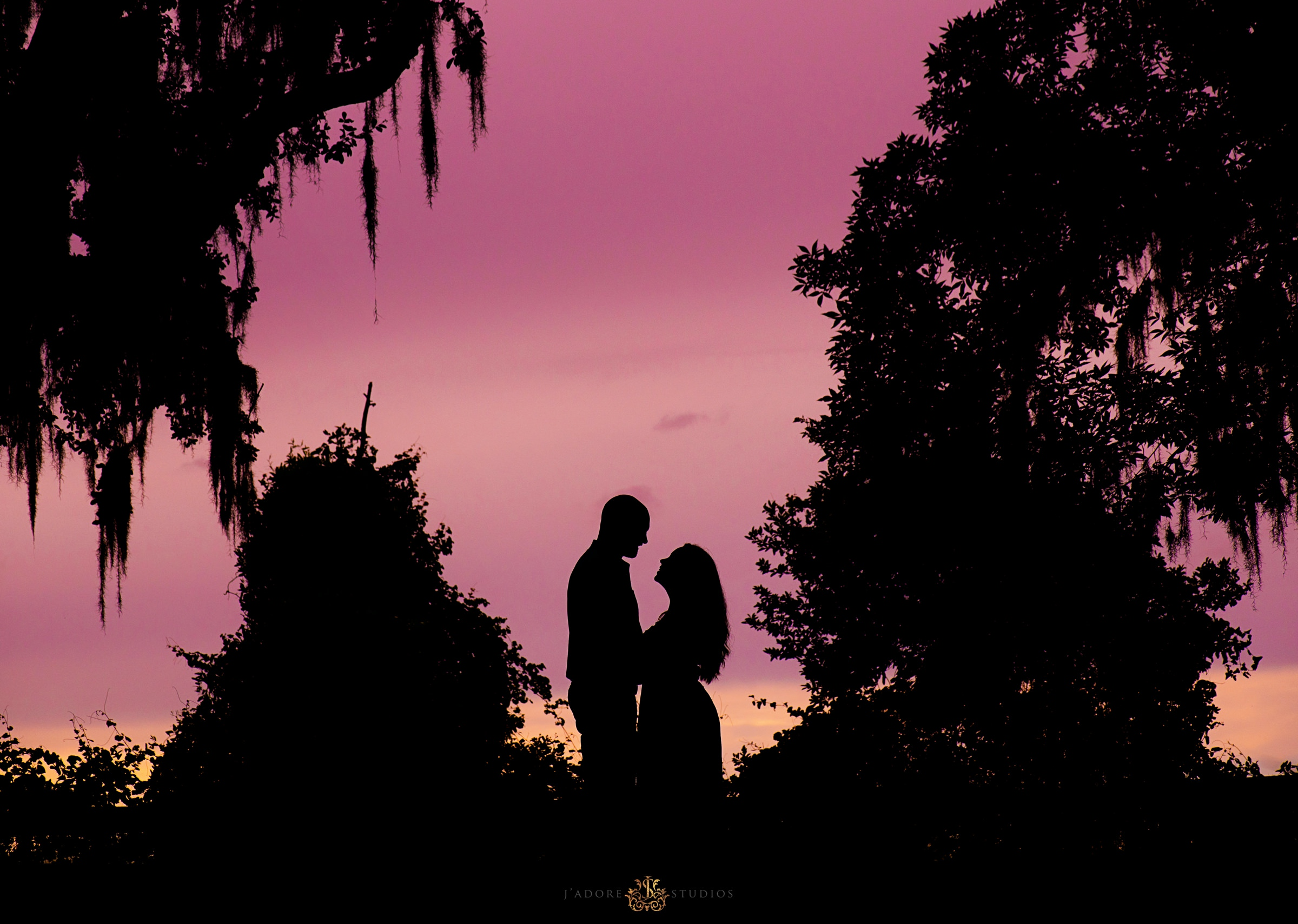 Sunset silhouette photo of couple laughing at Alpine Grove Park