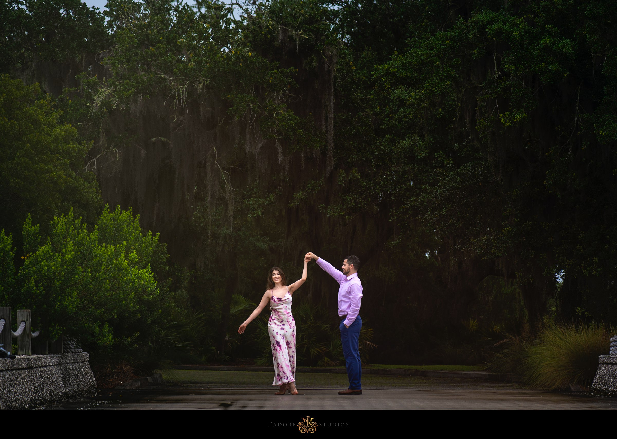 Couple dancing in front of mossy trees at Oyster Bay Yacht Club