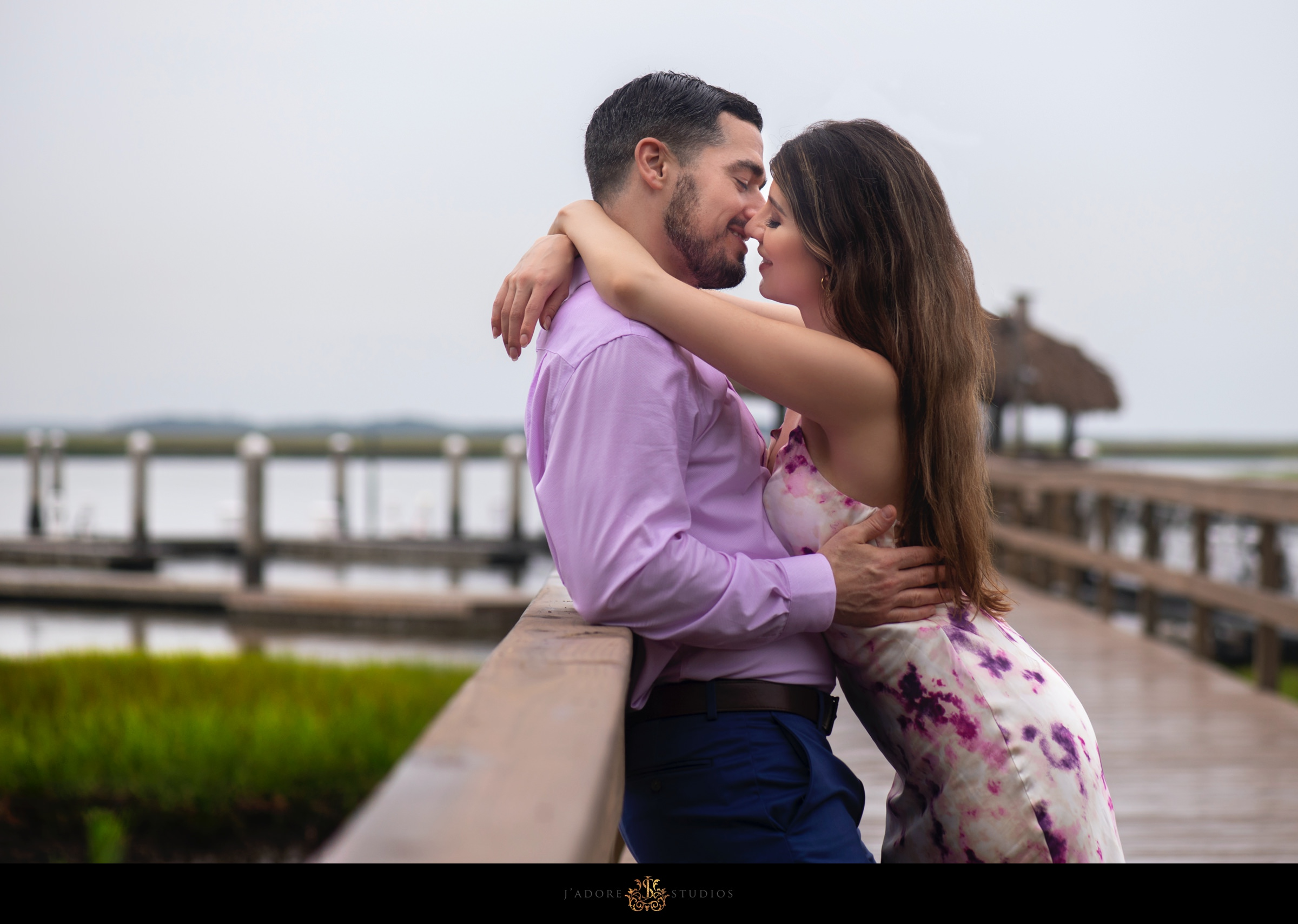 Couple leaning on railing on the dock at Oyster Bay Yacht Club