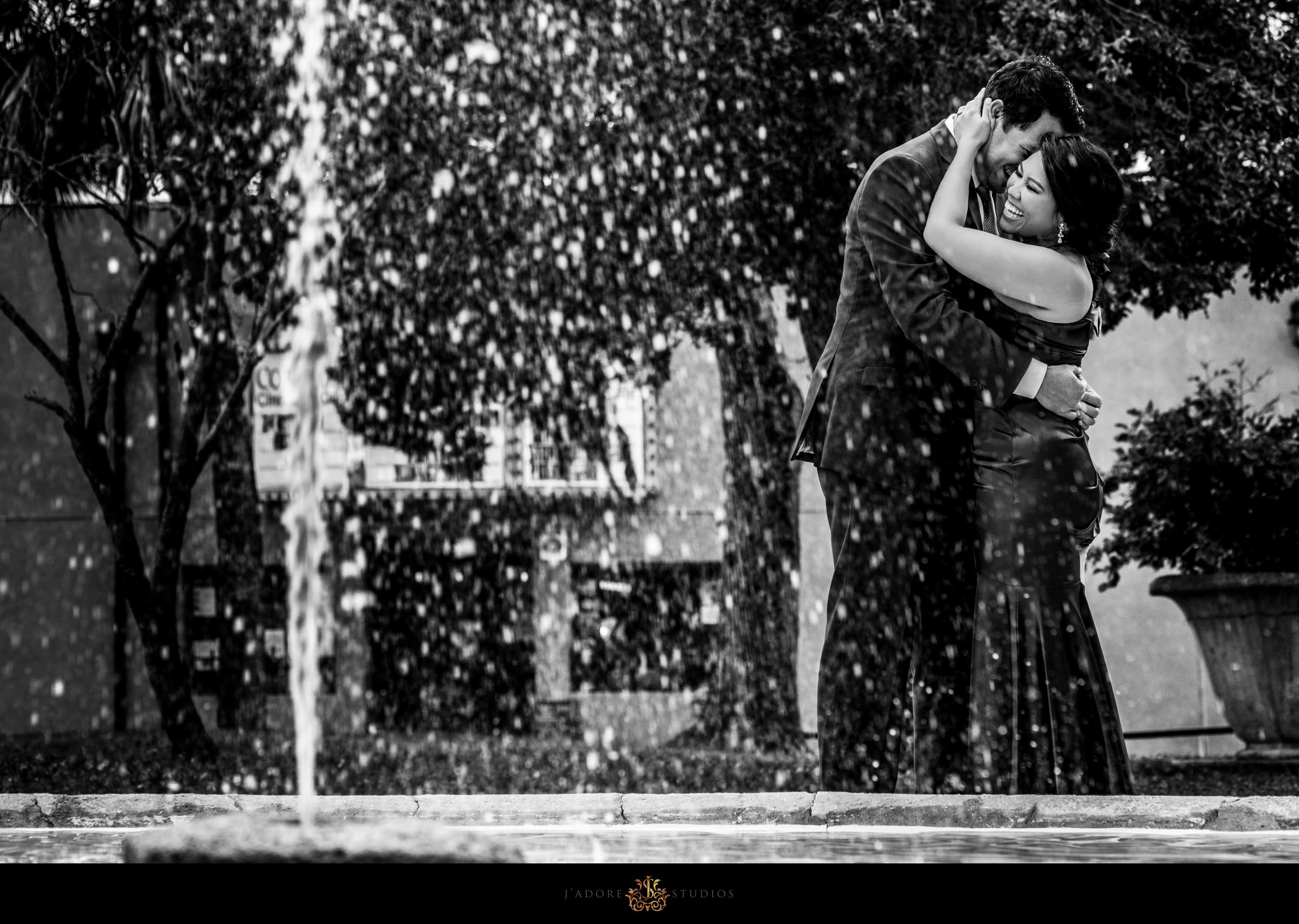 Couple hugging in front of Lightner Museum fountain