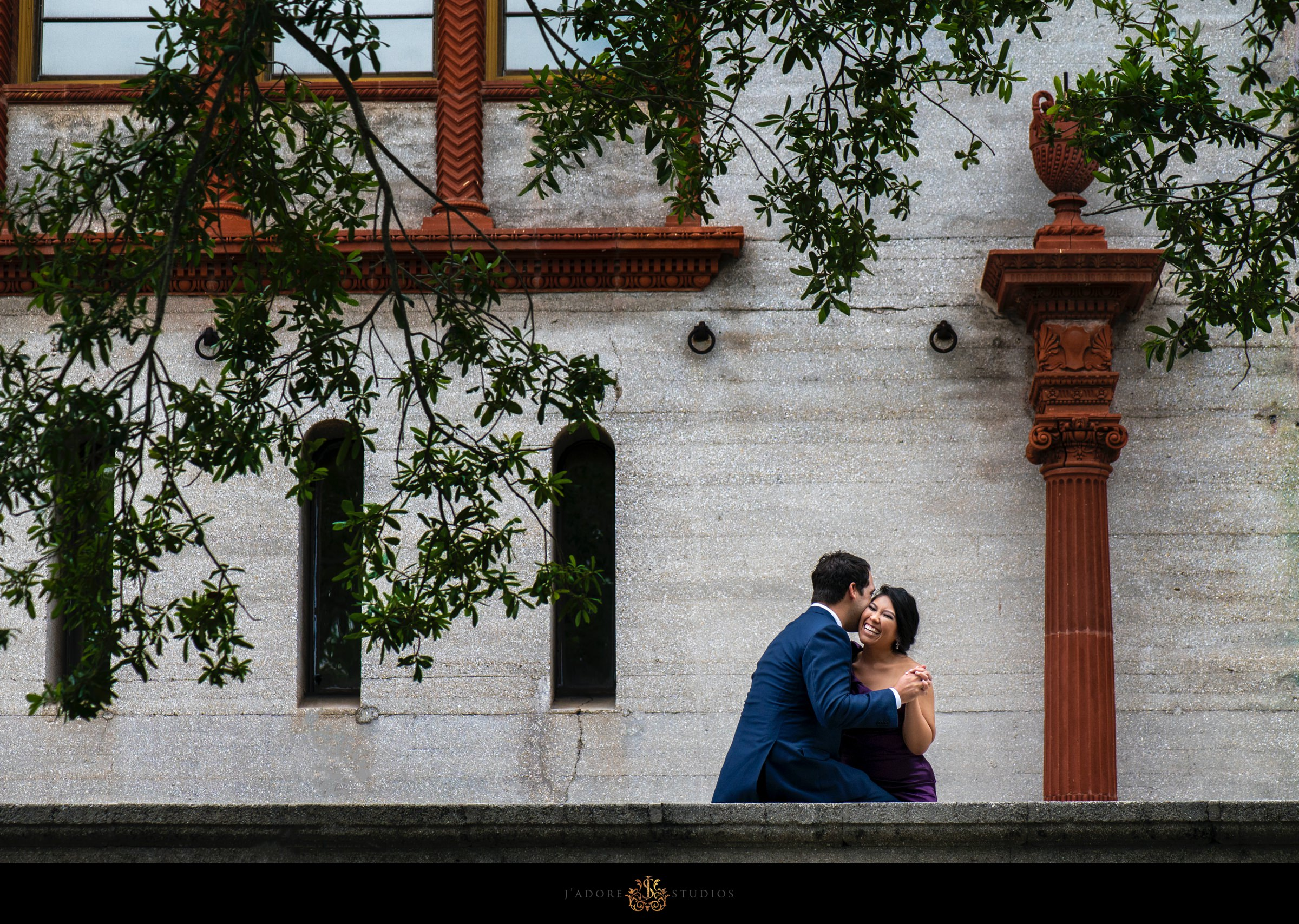 Couple hugging in front of lightner museum in saint Augustine Florida