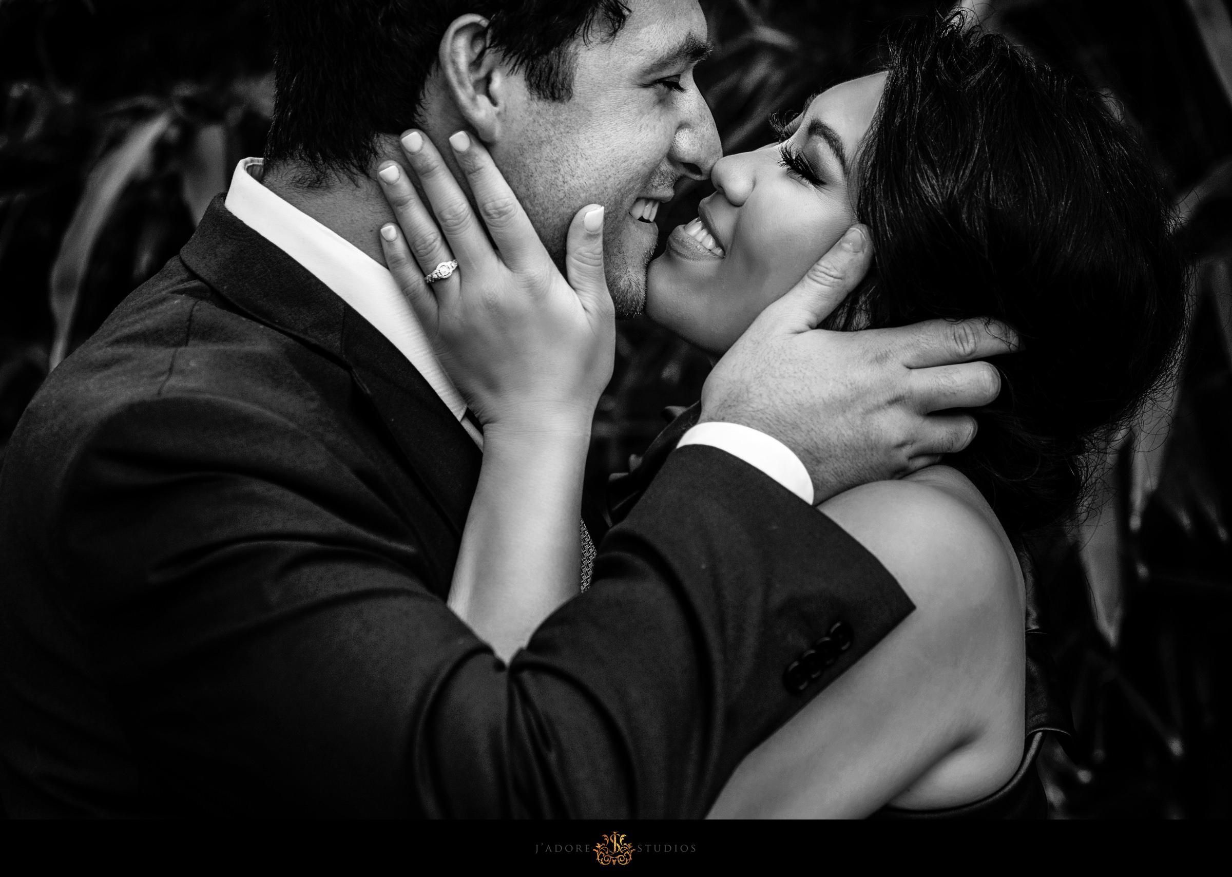 black and white closeup photo of couple kissing