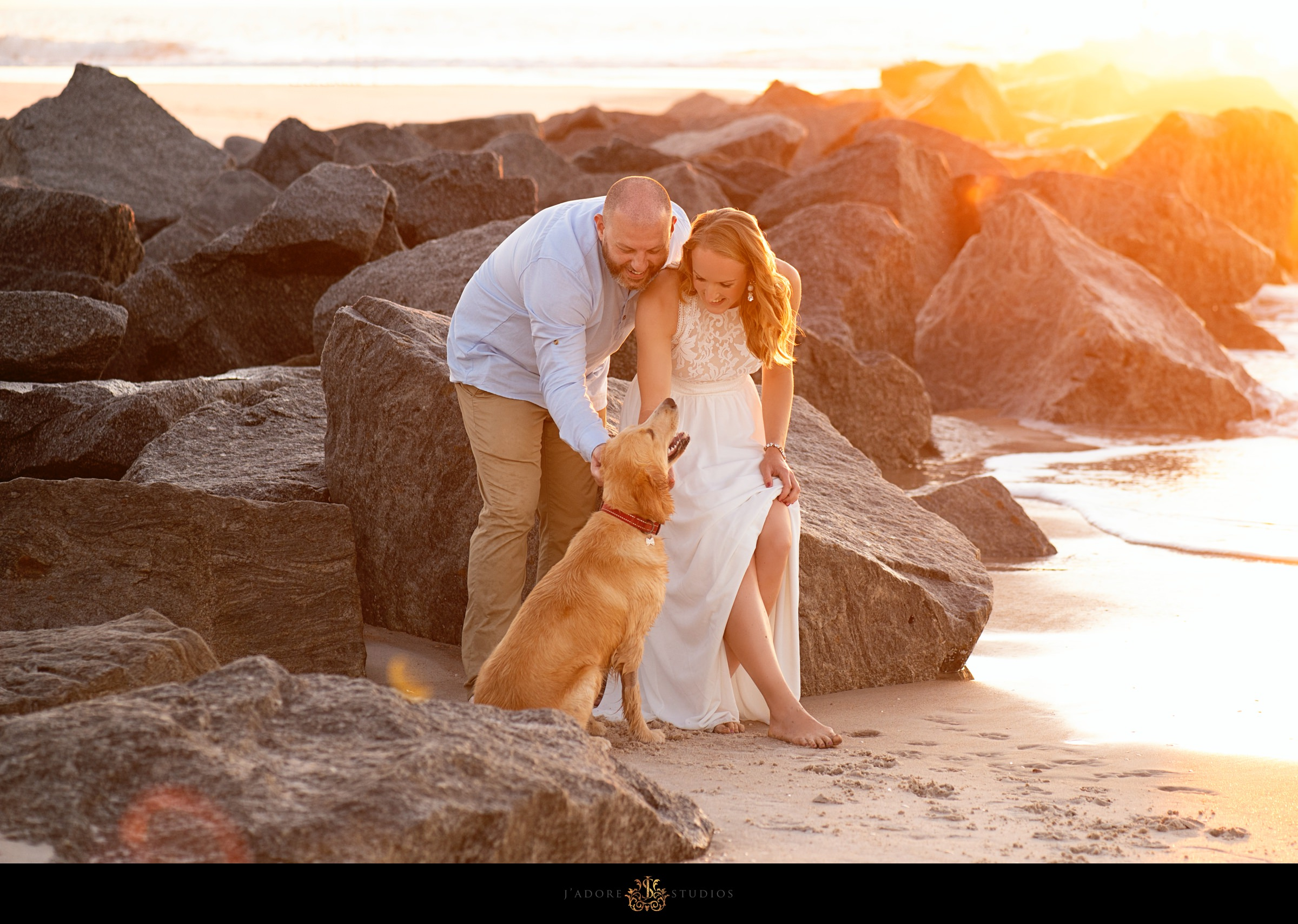 Saint Augustine engagement session couple on beach with dog