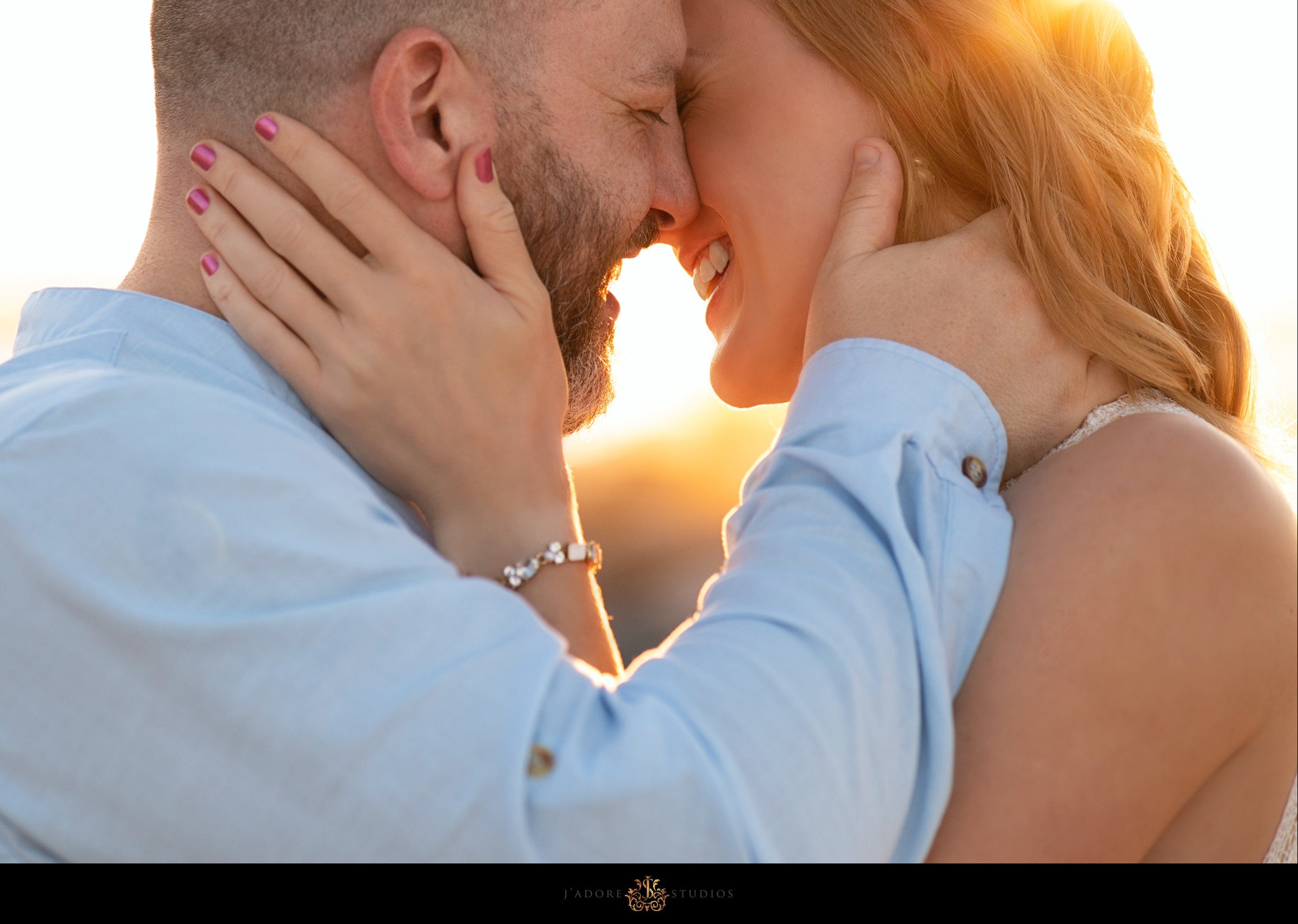 engagement session photo of couple kissing on the beach in Saint Augustine Florida