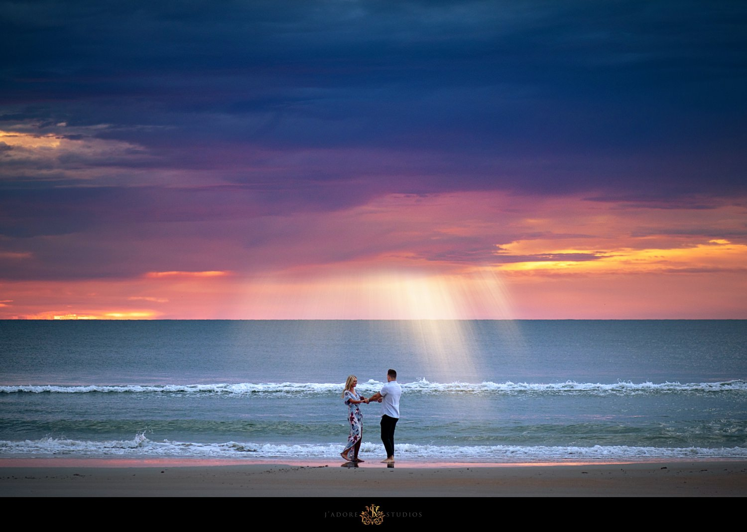 Sunrise photo of couple dancing in rays of light at Washington Oaks State Park in Palm Coast Florida