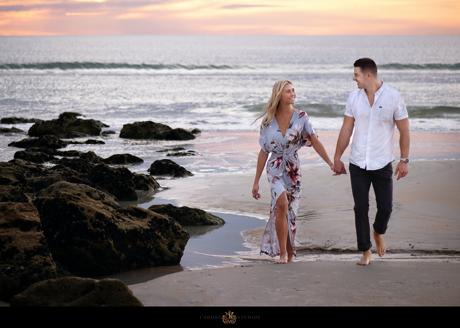 Engagement session of couple on beach at Washington Oaks State Park