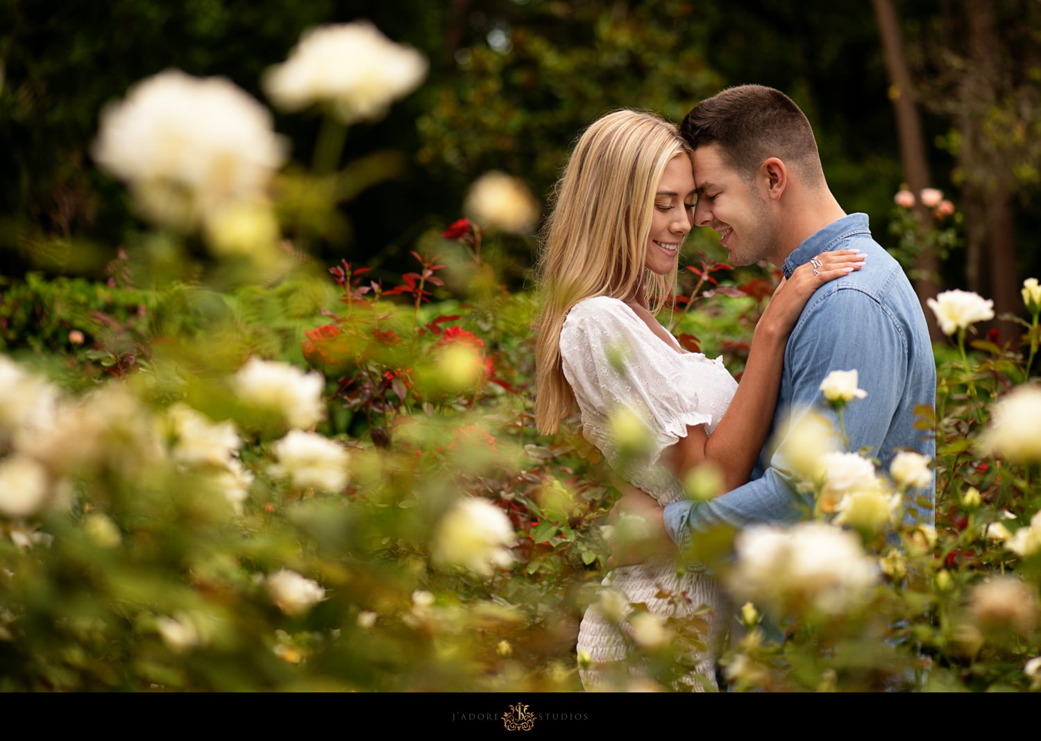 Couple hugging in the rose garden at Washington Oaks State Park