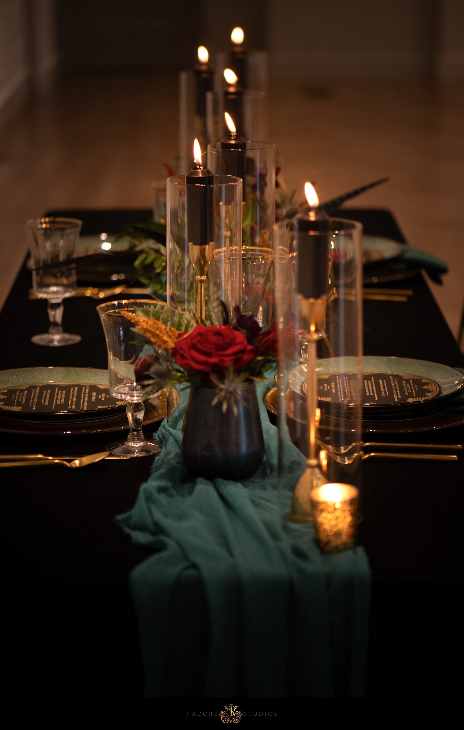 Black candles with black linen and teal runner