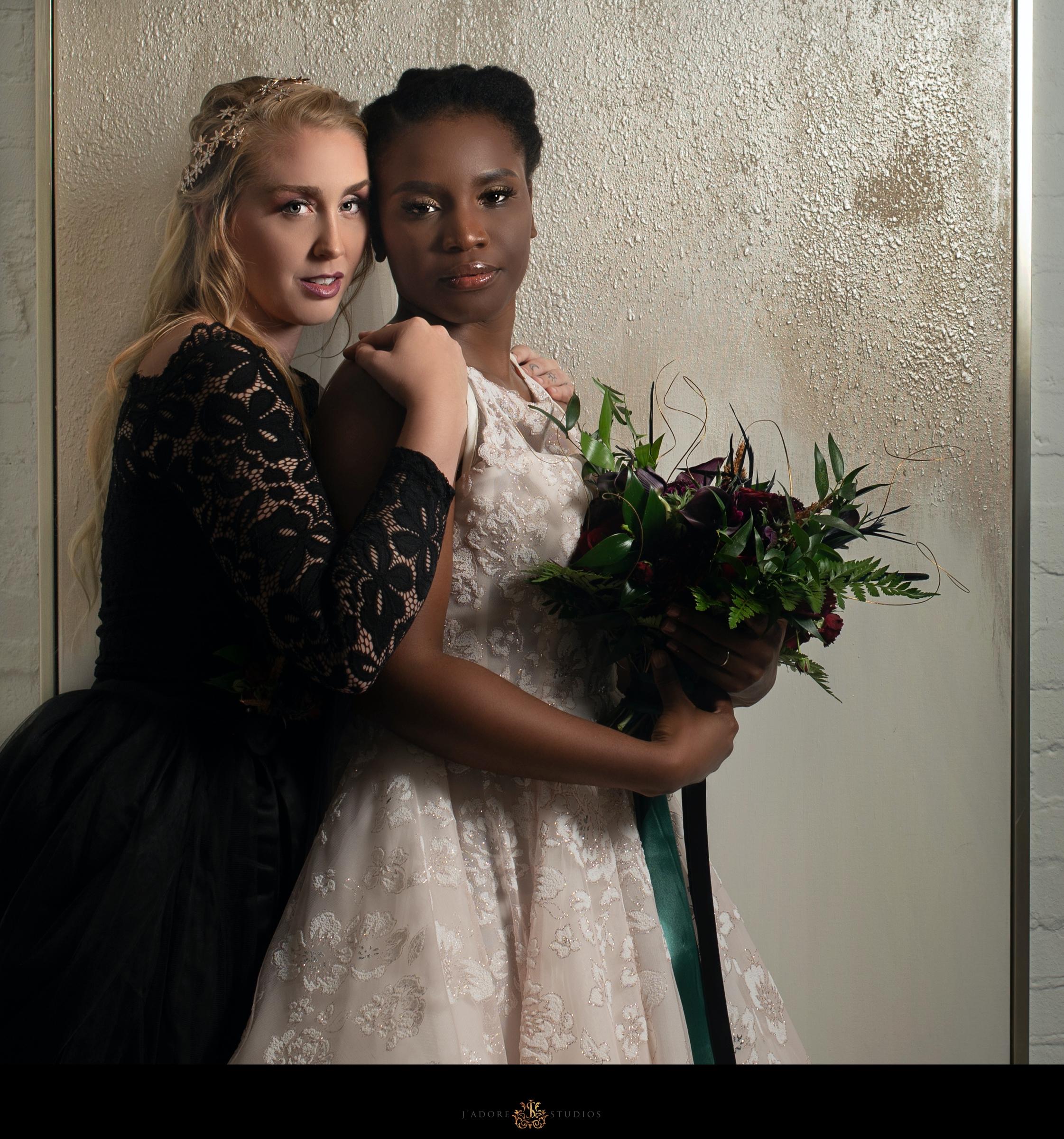 Bride and Bride hug inside of Clay Theatre