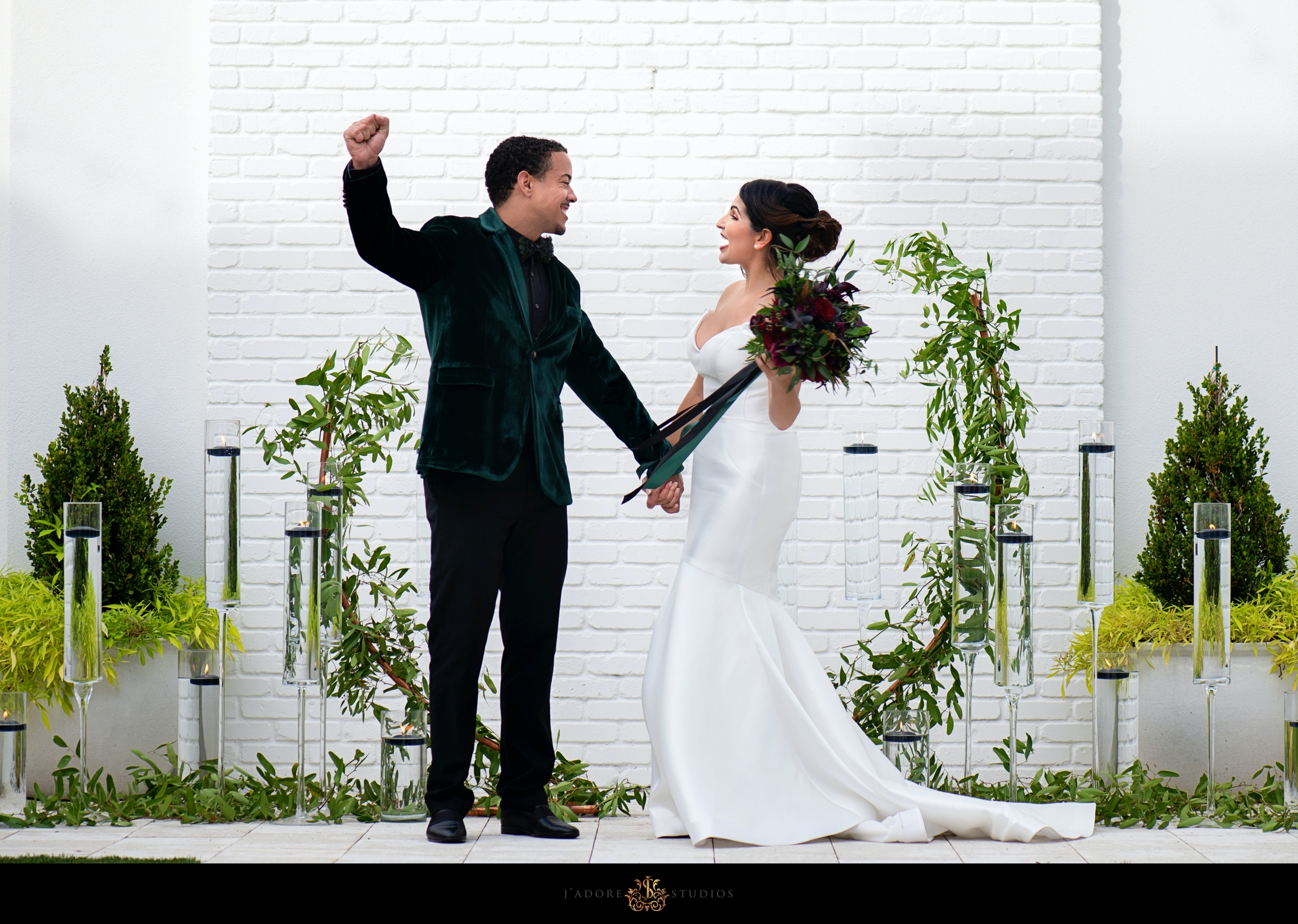 Bride and Groom Cheer after first kiss at alter at Clay Theatre