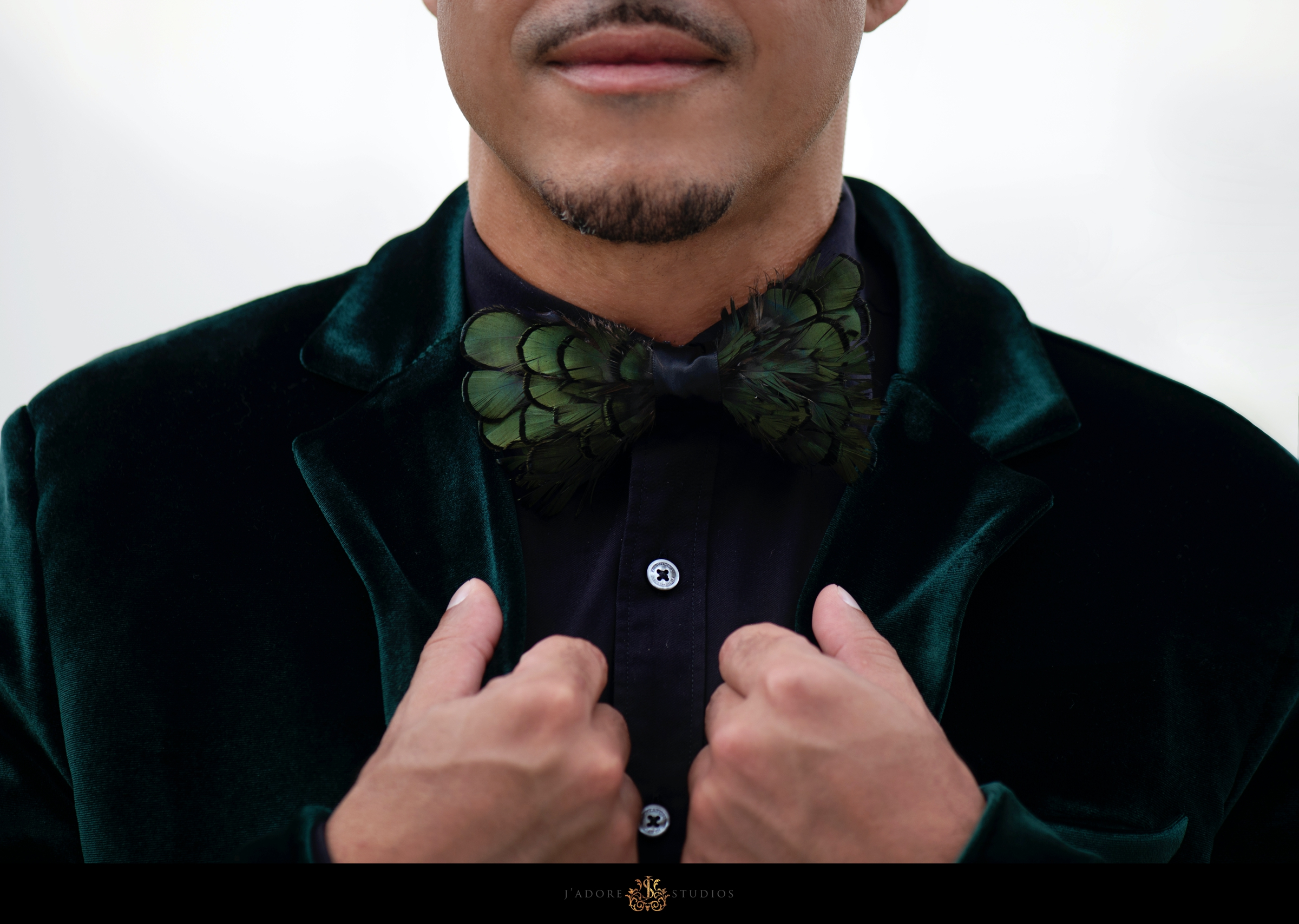 peacock feather bow tie and green jacket