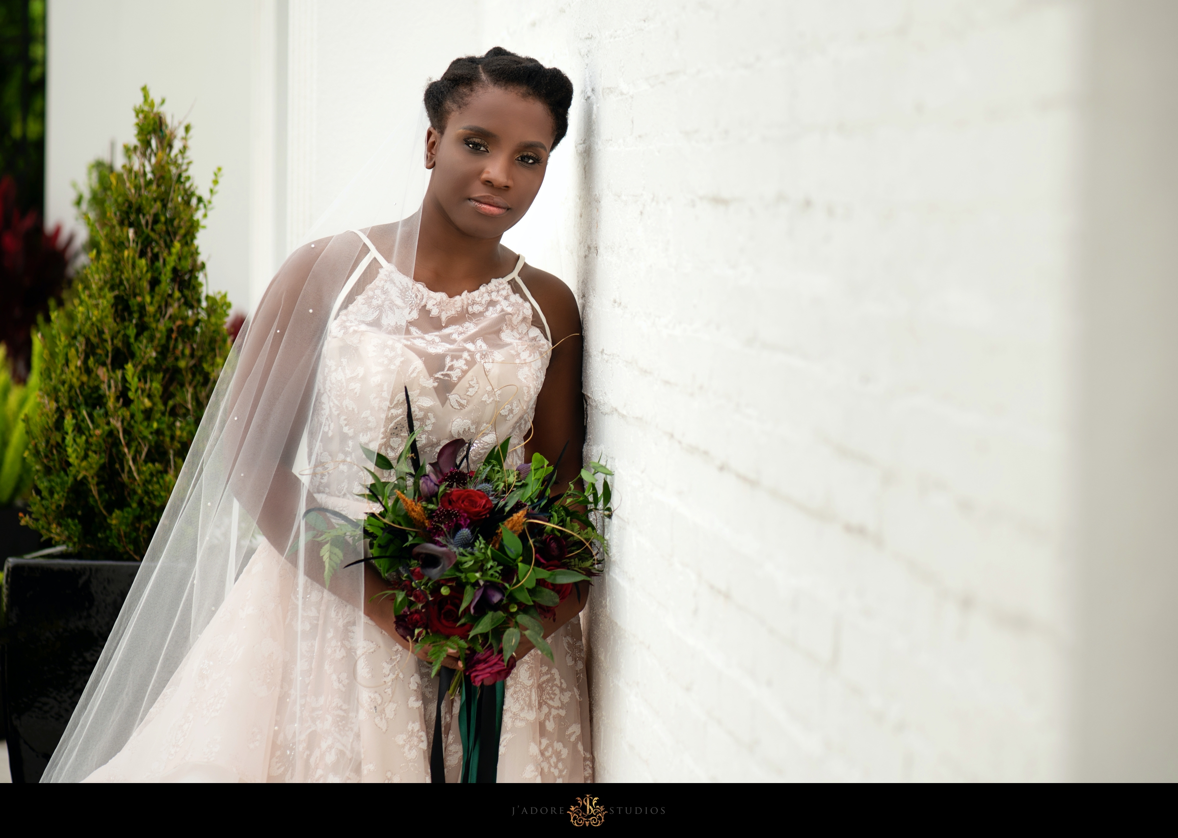 Bride in blush dress poses at Clay Theatre