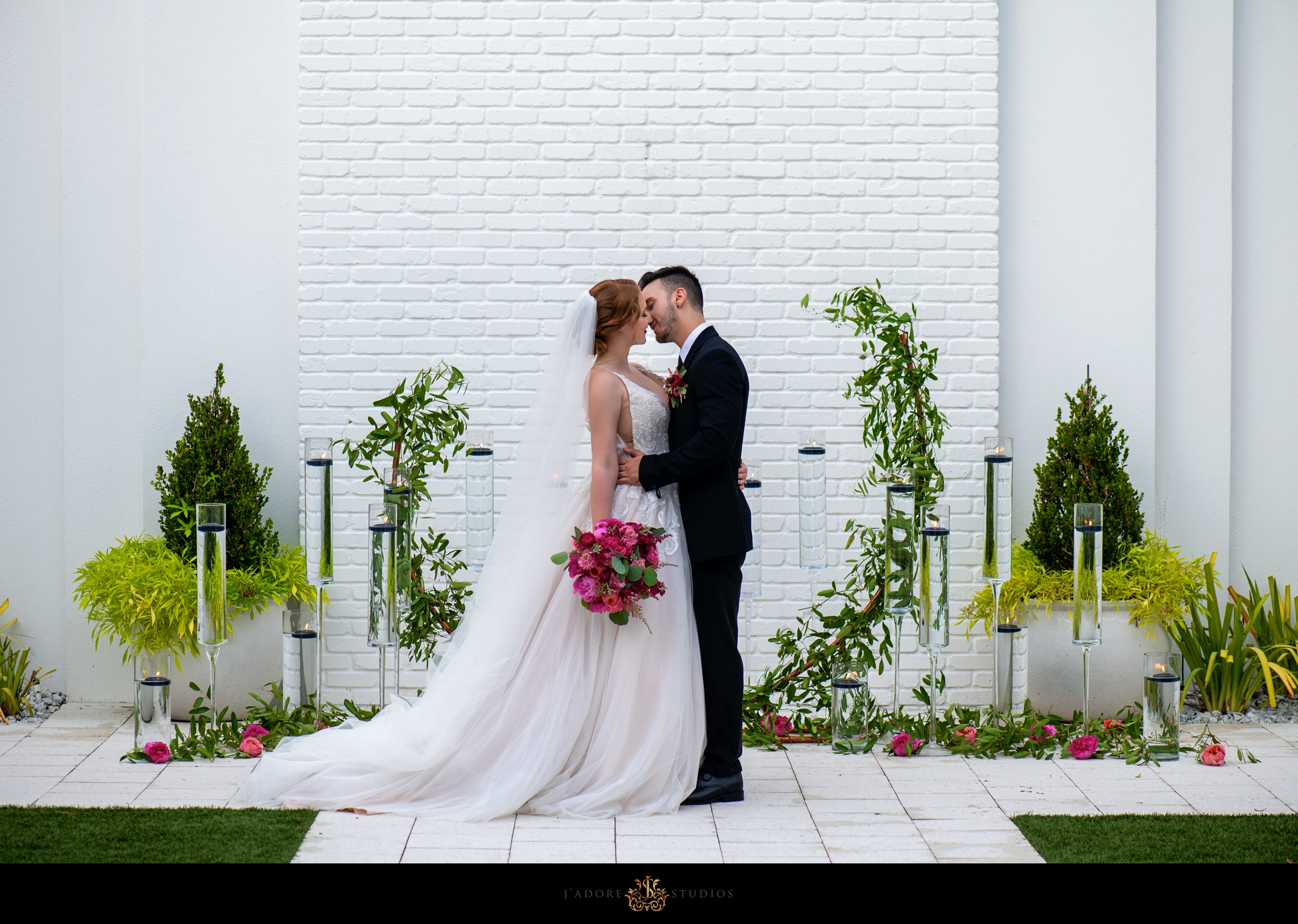 First kiss at alter at Clay Theatre Wedding Venue in Green Cove Springs Florida