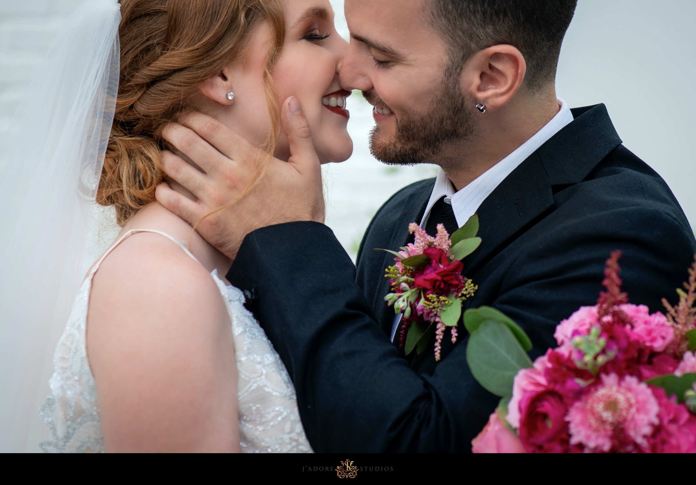 Close up photo of bride and groom smiling
