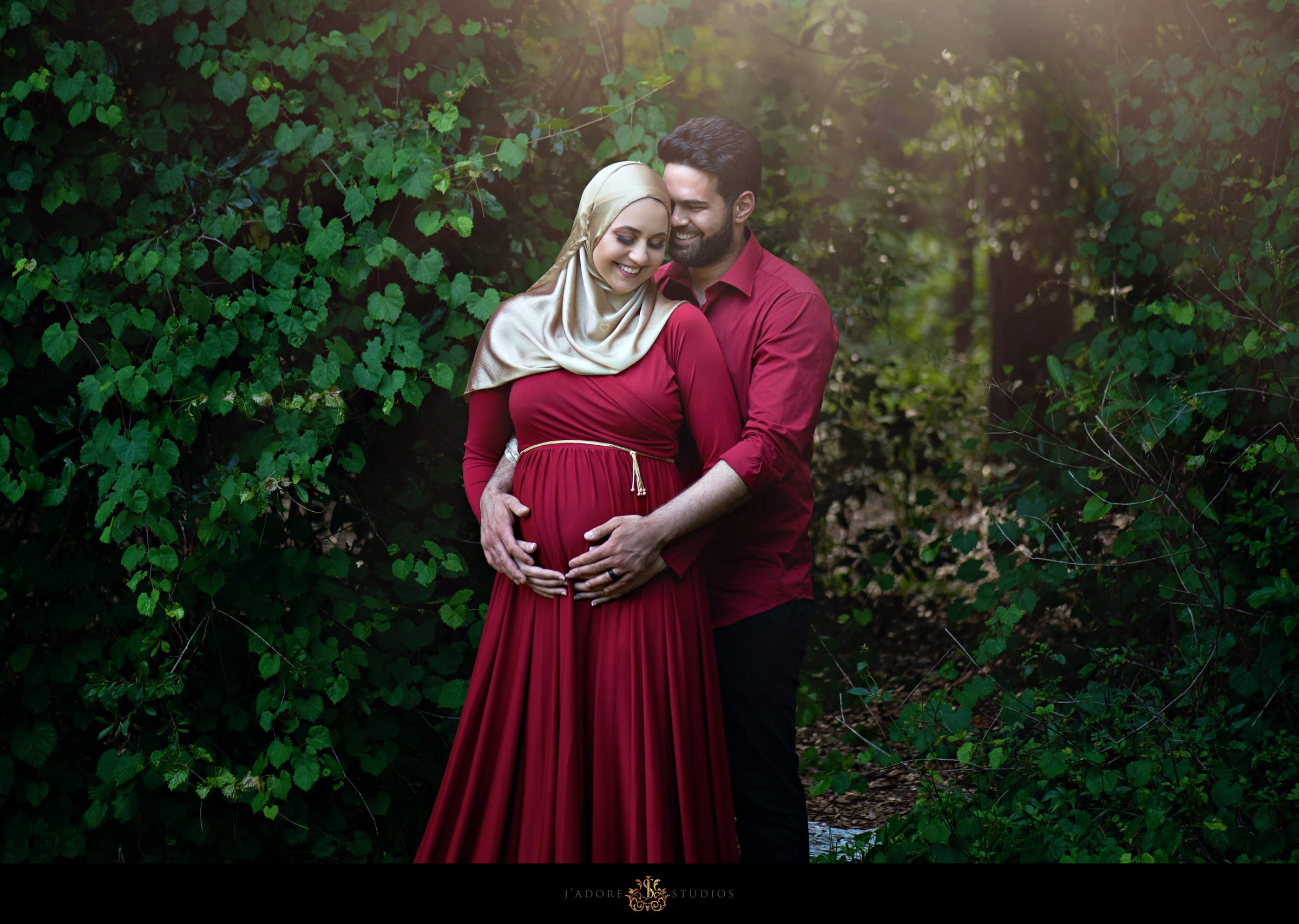 Husband hugs pregnant wife in park in Jacksonville Florida
