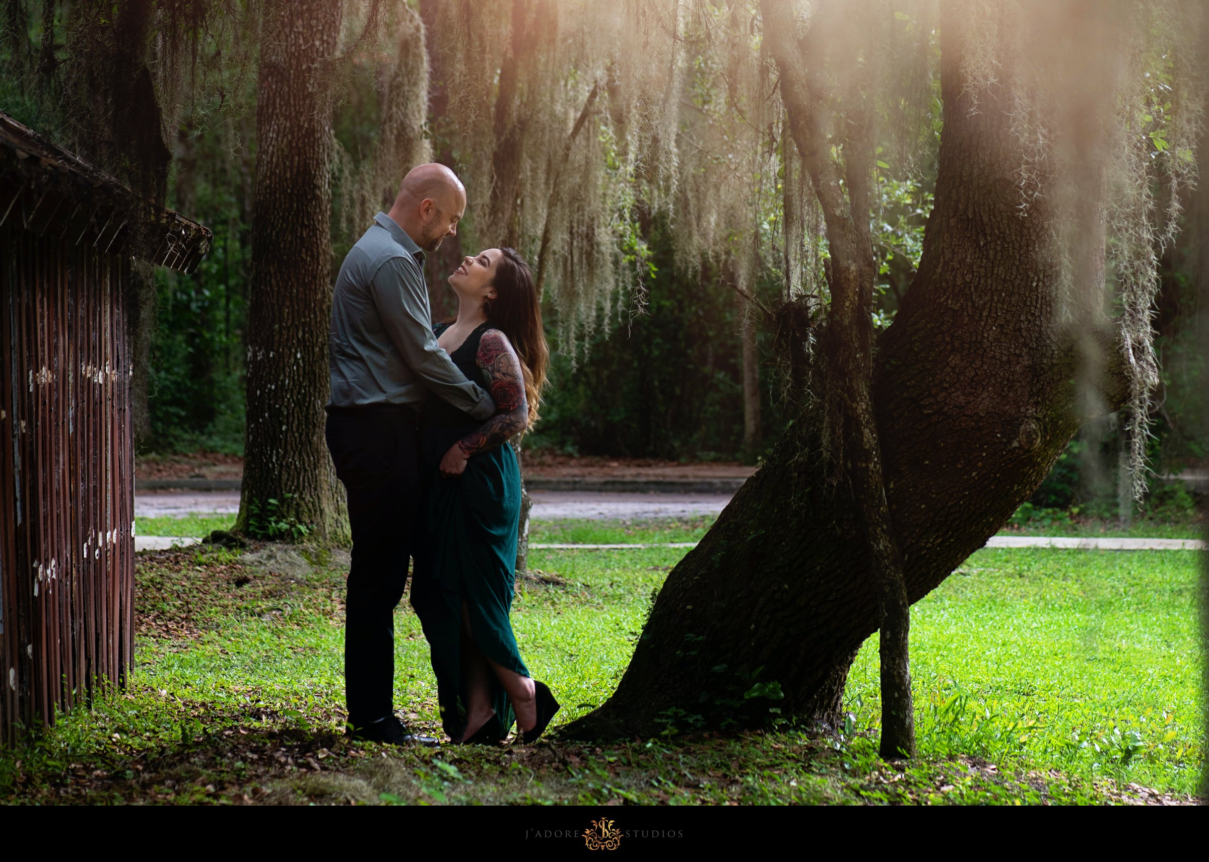 Couple gazing into each others eyes under tree at Alpine Grove Park