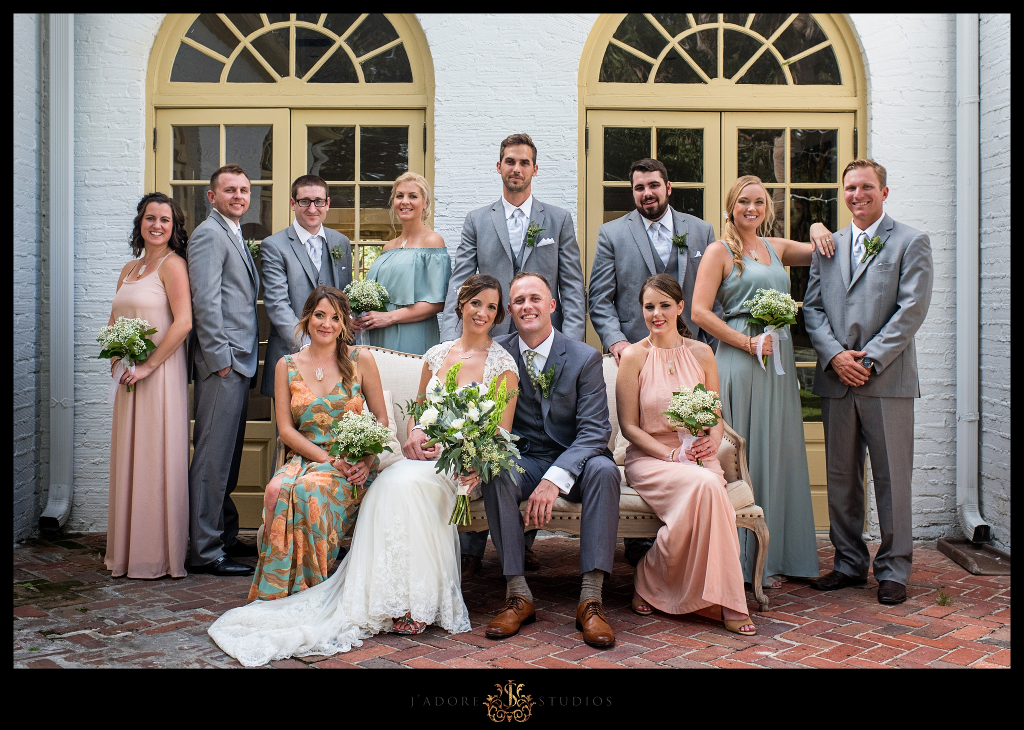 Bridal party photo in front of the Ribault Club venue
