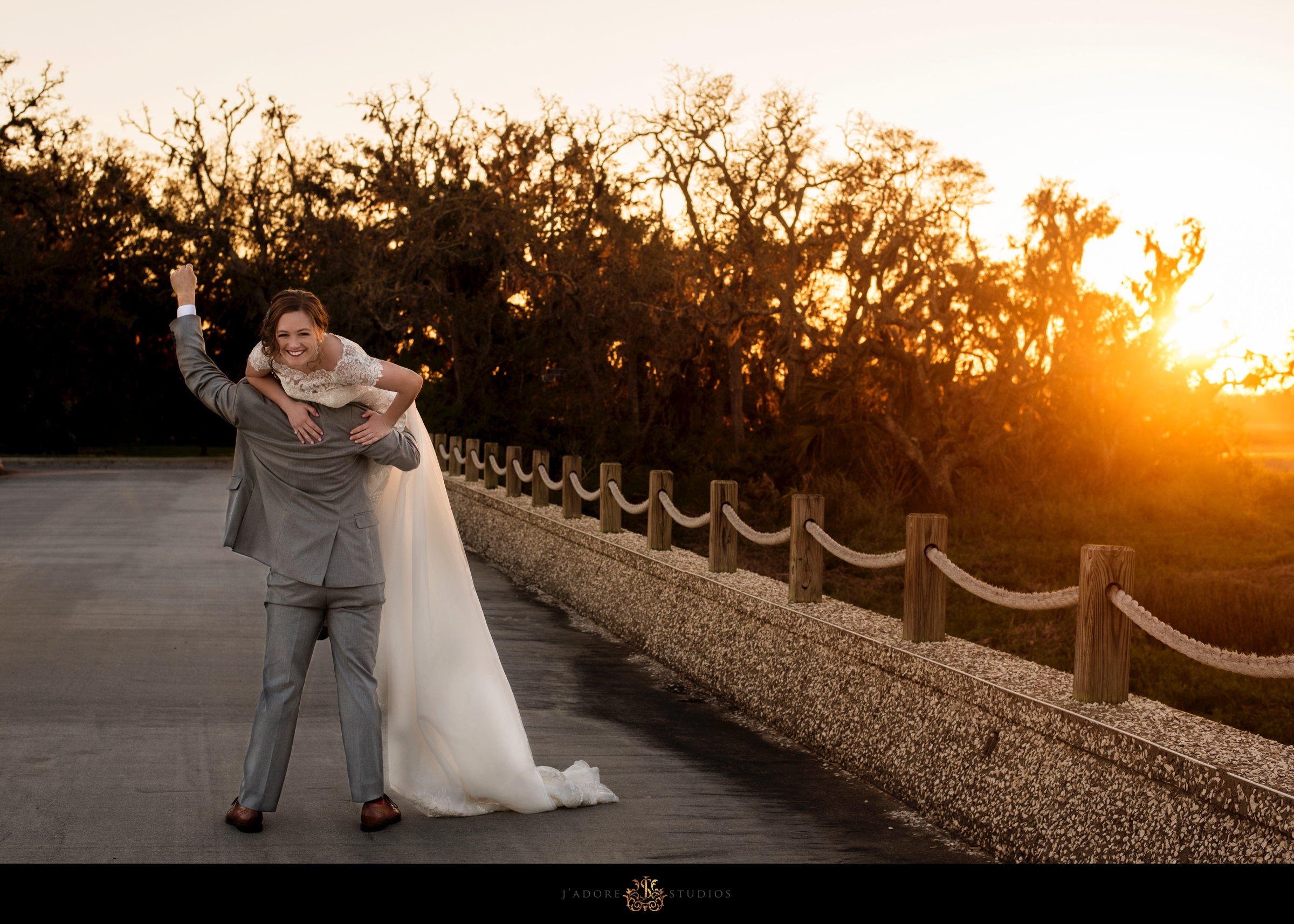 Sunset photo of couple on bridge at Oyster Bay Yacht Club