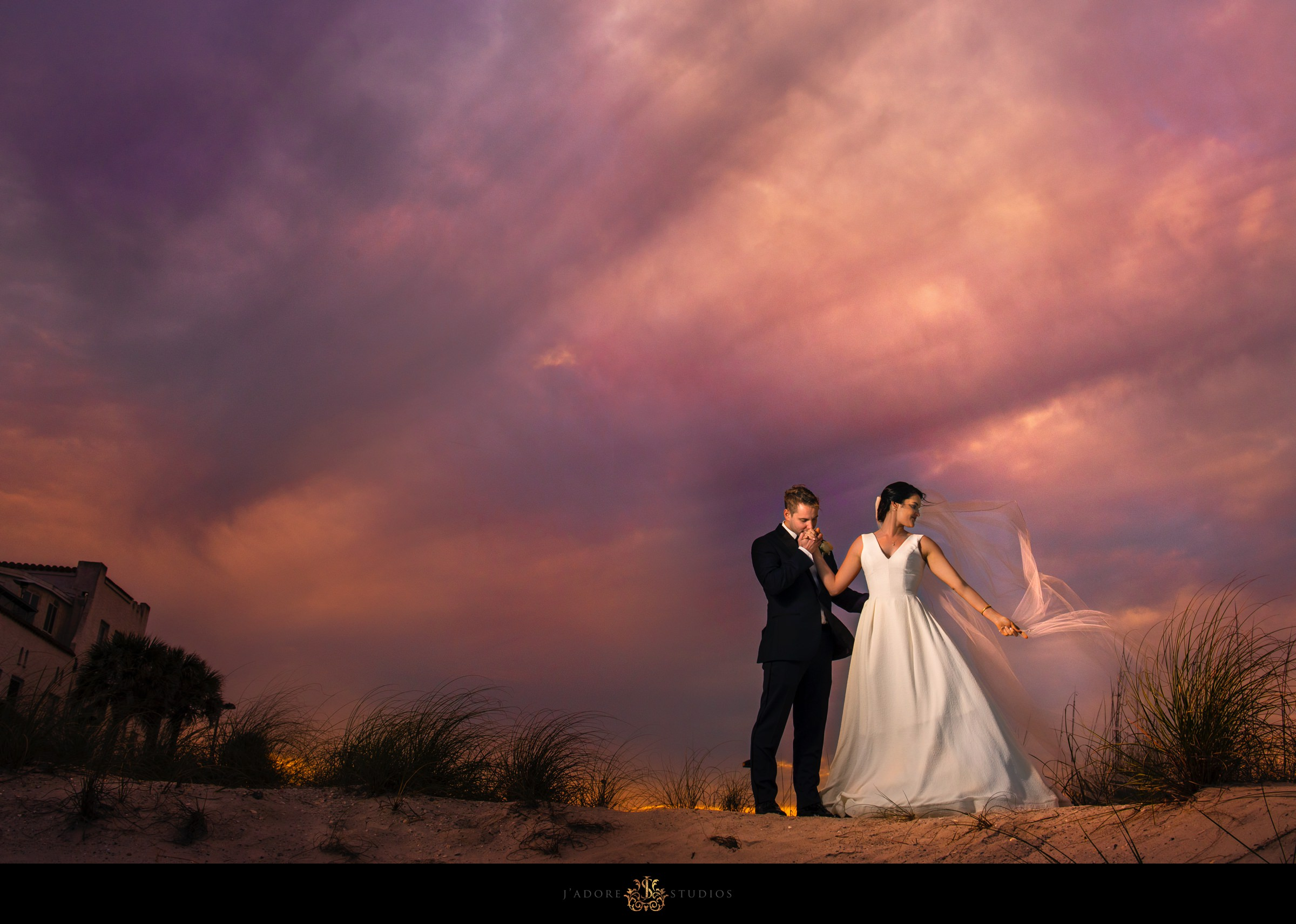 Sunset photo of bride and groom in front of the Casa Marina in Jacksonville Beach