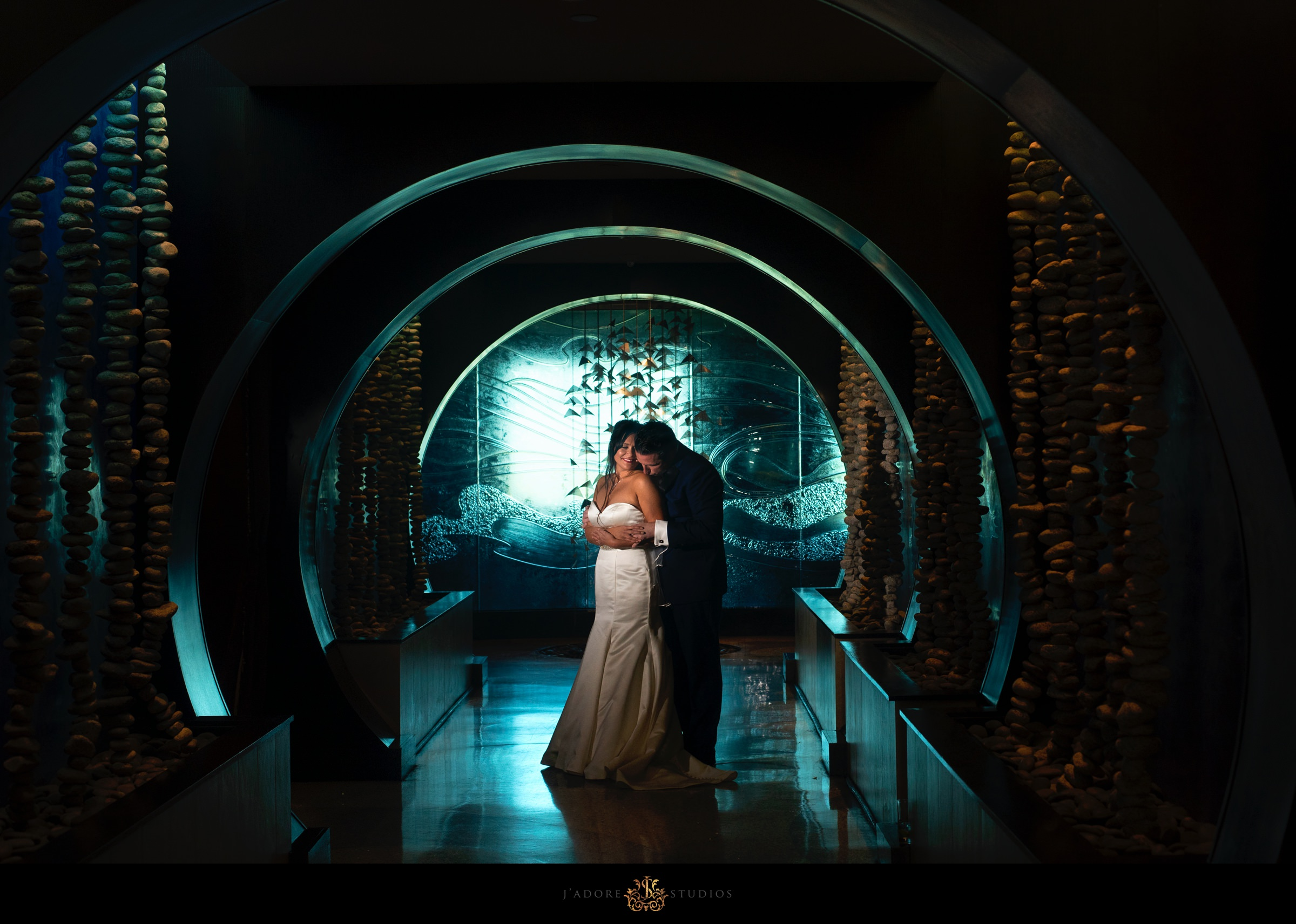 Couple kissing in the blue hallway at One Ocean Resort & Spa