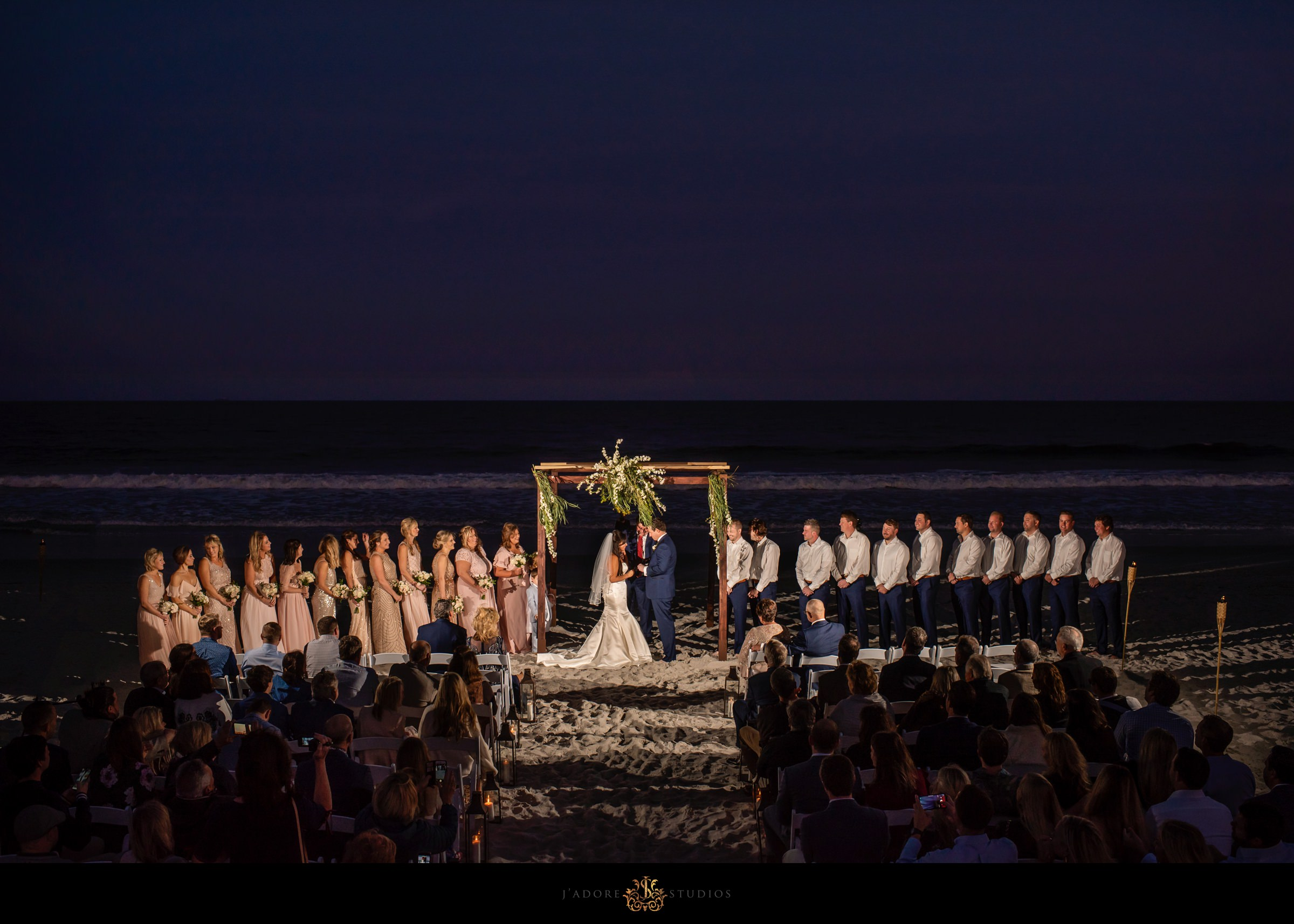 Sunset ceremony on the beach at One Ocean Resort & Spa